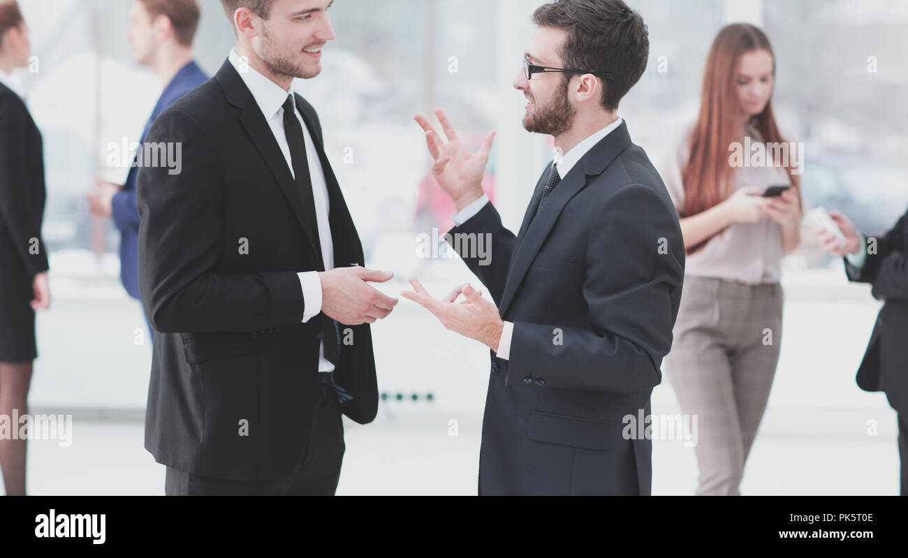 close up.business colleagues discuss business problems standing in the office - Stock Image