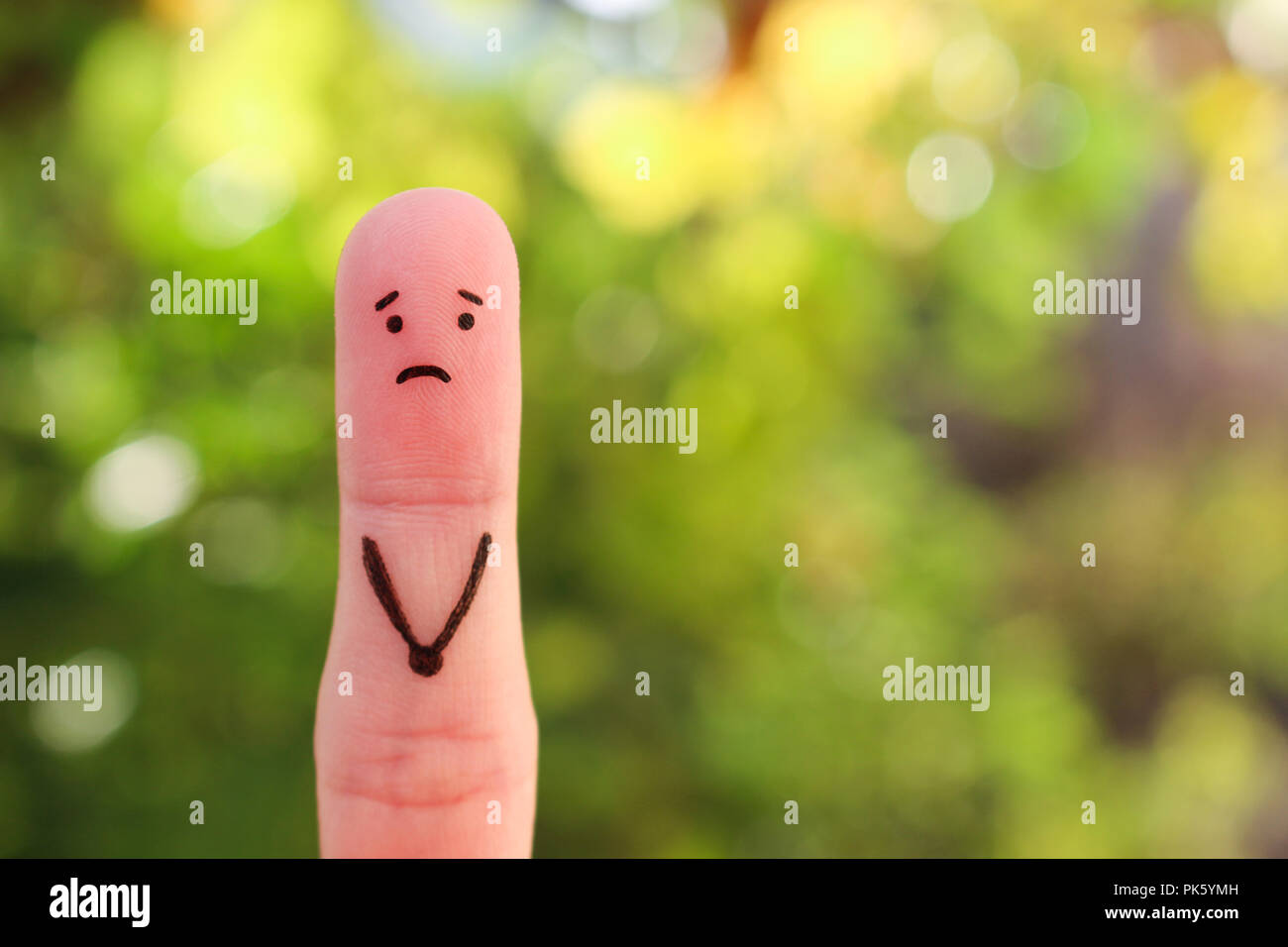 Finger art of a lonely man. - Stock Image
