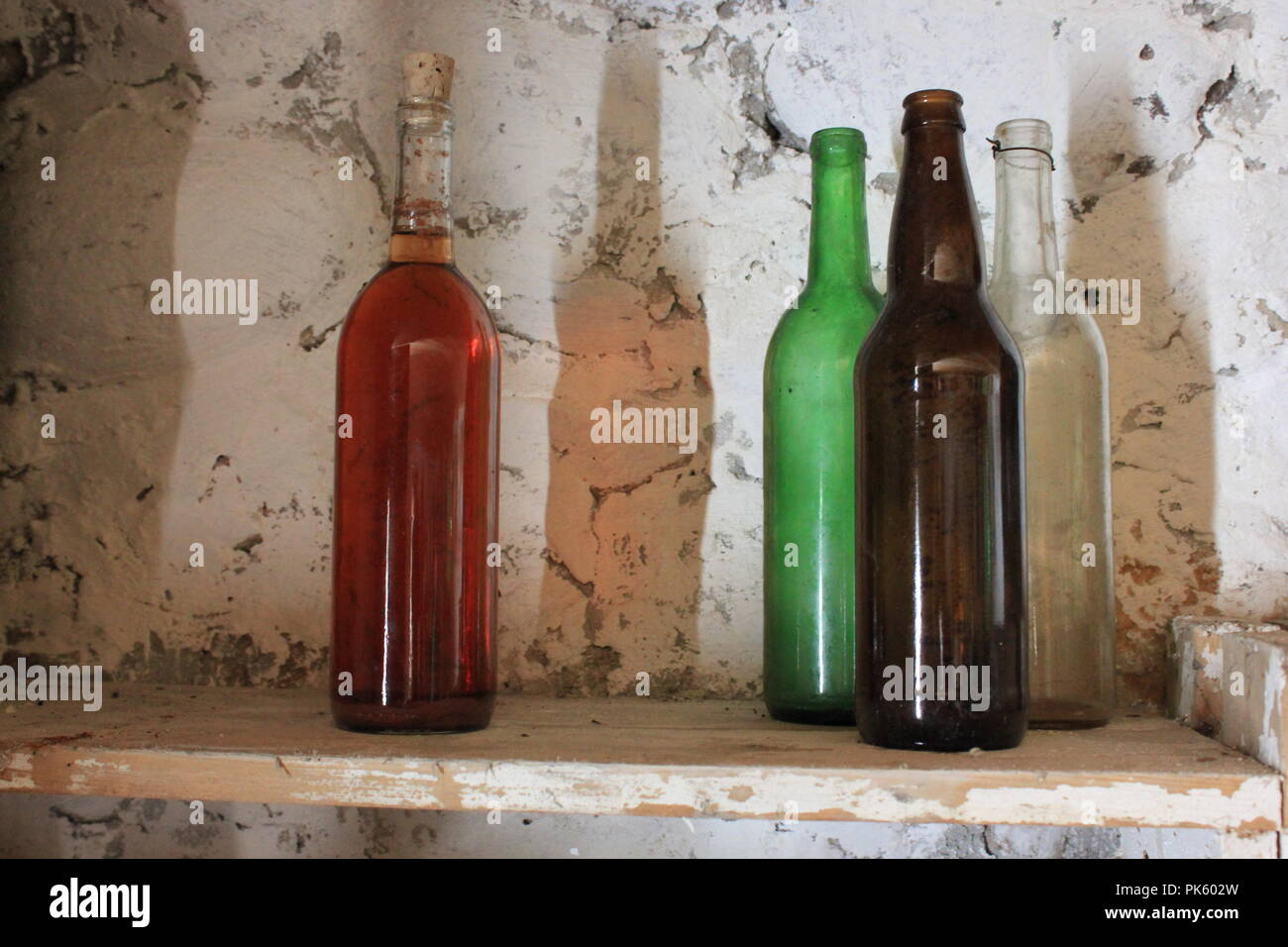 Glass bottles on a shelf in a canning cellar at the Volkening Heritage Farm in Schaumburg, Illinois on a late summer day. - Stock Image