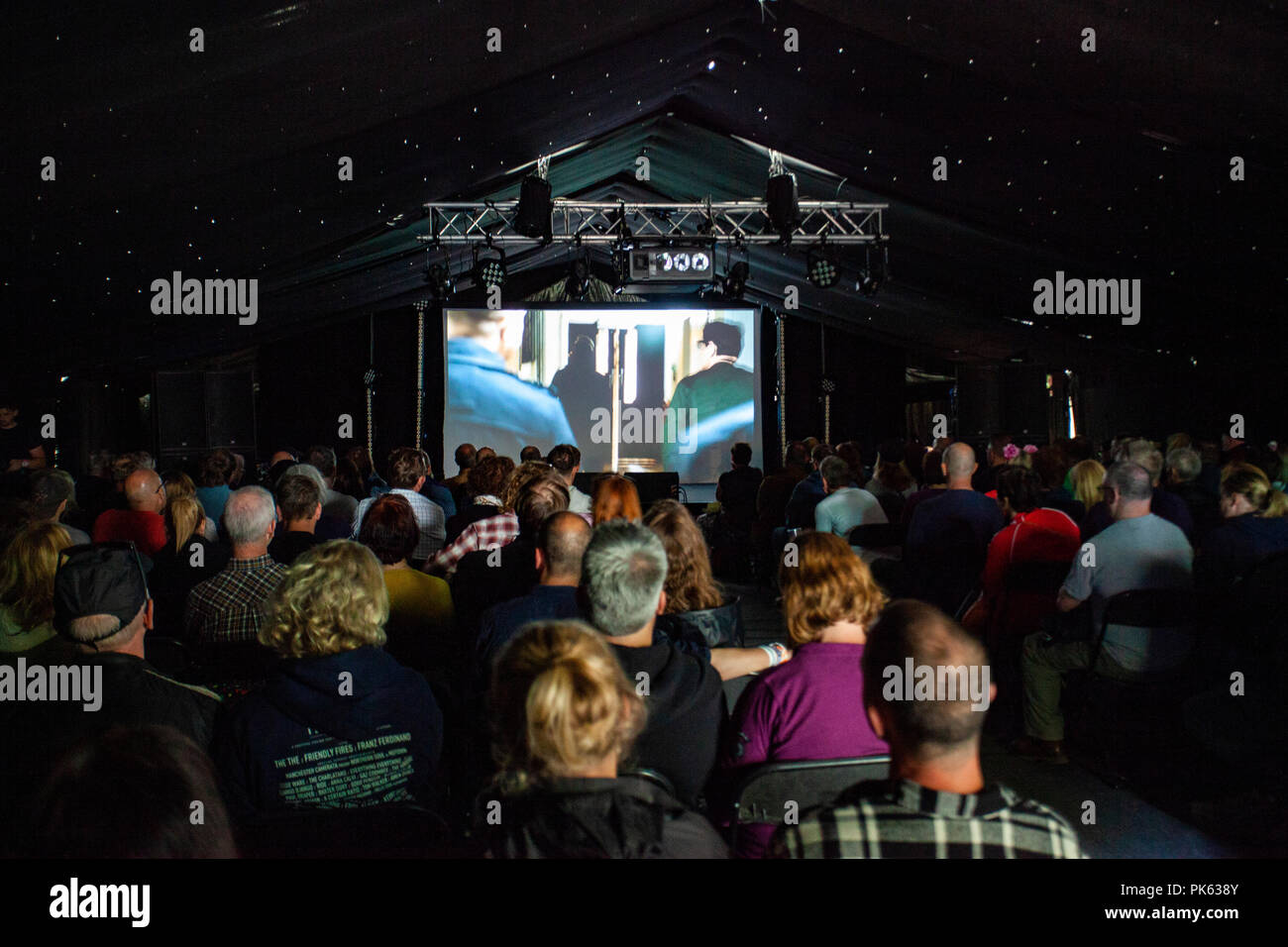 Fans of New Order watching the first ever screening of the documentary movie about New Order called Decades, screened at Festival Number 6, Portmeirion - Stock Image