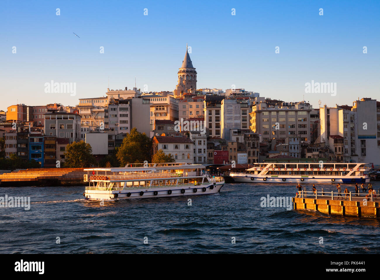 The beautiful view of the Galata Tower and Golden Horn at sunset, Istanbul, Turkey Stock Photo