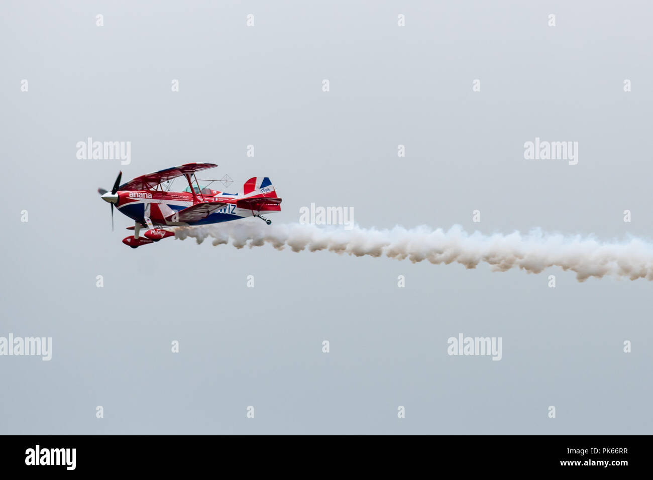 A rare moment of level flight for Rich Goodwin during his aerobatic display in his highly modified Pitts Special S2S Biplane. - Stock Image