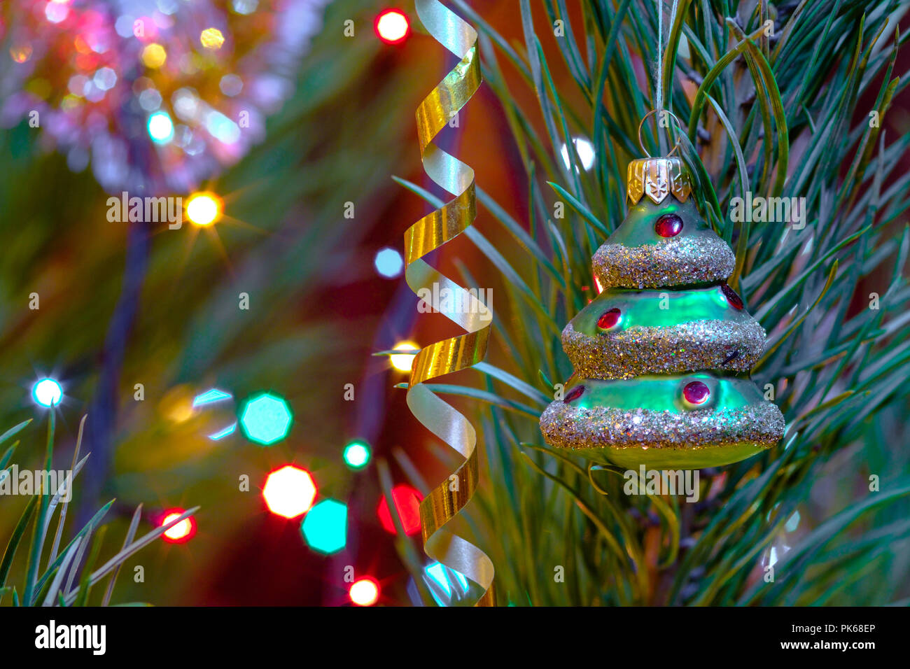 christmas toys on the christmas tree new year decoration serpentine and lights of garlands