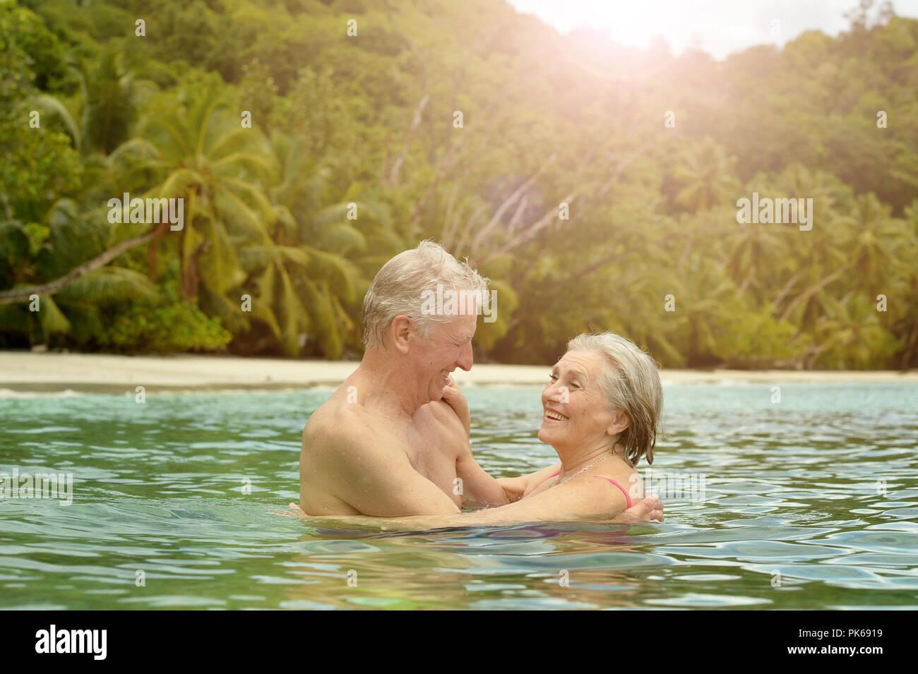 Elderly Couple Having Fun At Tropical Beach Stock Photo 218341685