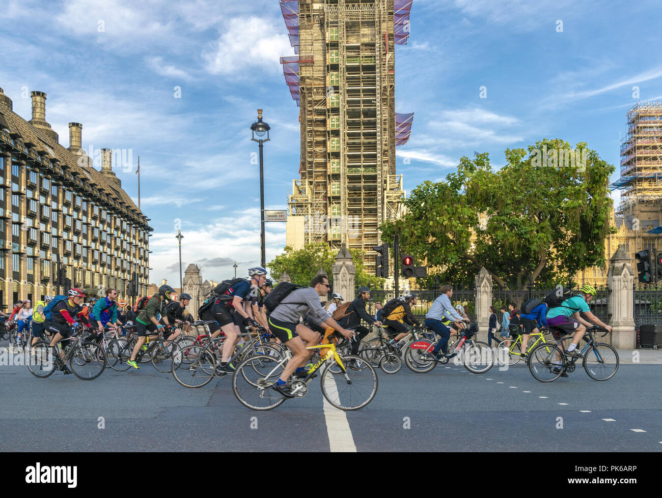 10 September 2018 - London, England. Busy rush hour scene in Parliament Square. Active Londoners cycling from work. - Stock Image