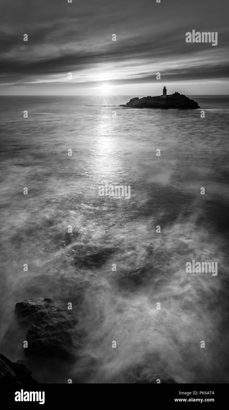 Sun streaming over water, Godrevy Lighthouse, Cornwall - Stock Image