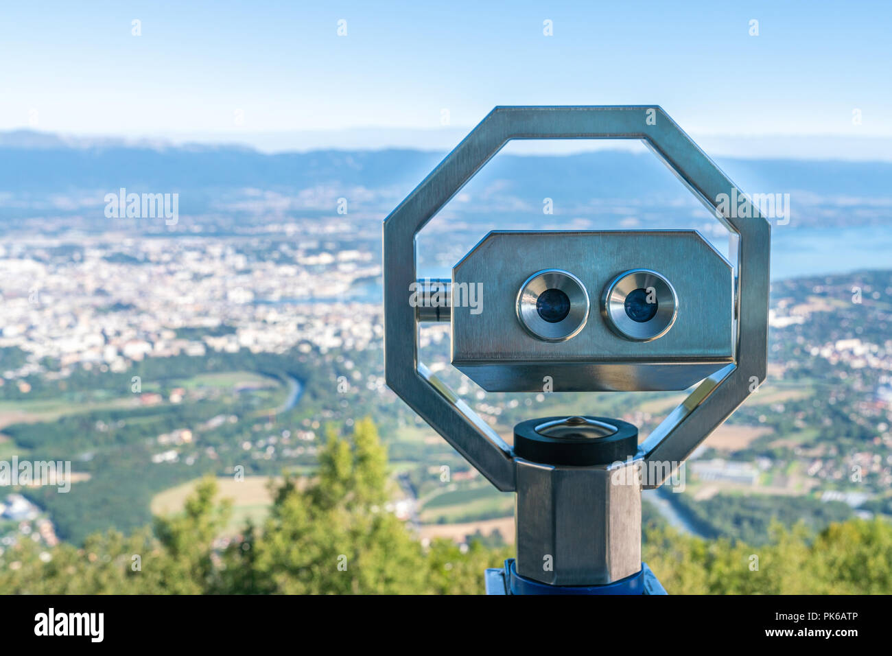 Coin operated binoculars on Mont Saleve located in France over looking city panorama of Geneva, Switzerland. - Stock Image