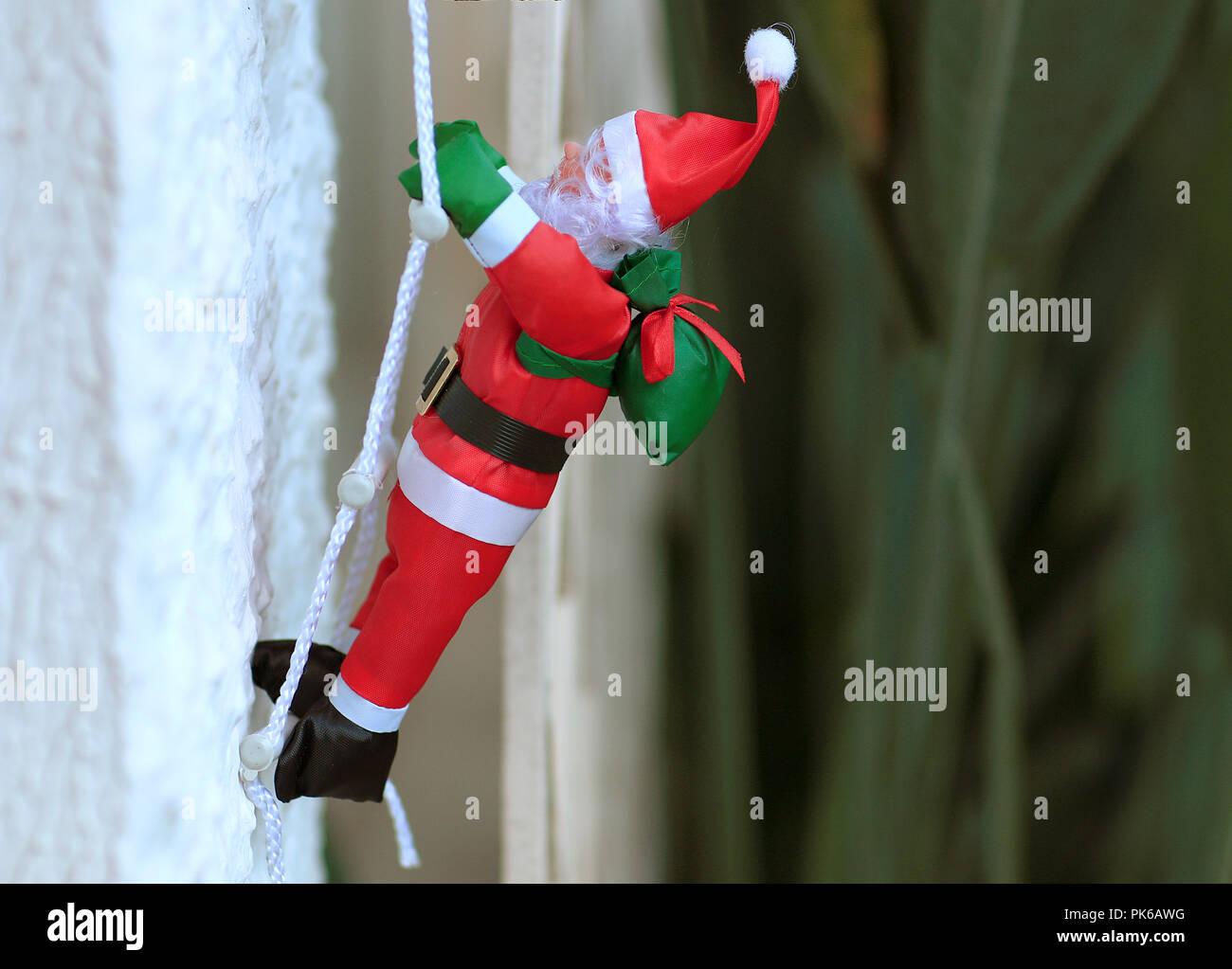 Merry Christmas Religious.Santa Claus Climbing The Chimney Merry Christmas Religious