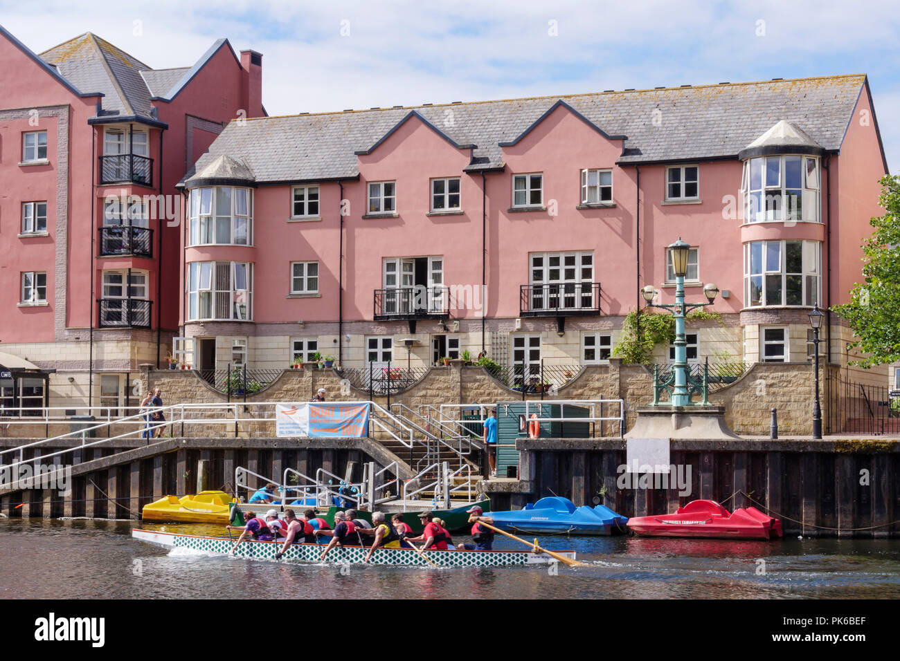 Rowers going past Butts Ferry River Exe Exeter Quay Exeter Devon England - Stock Image