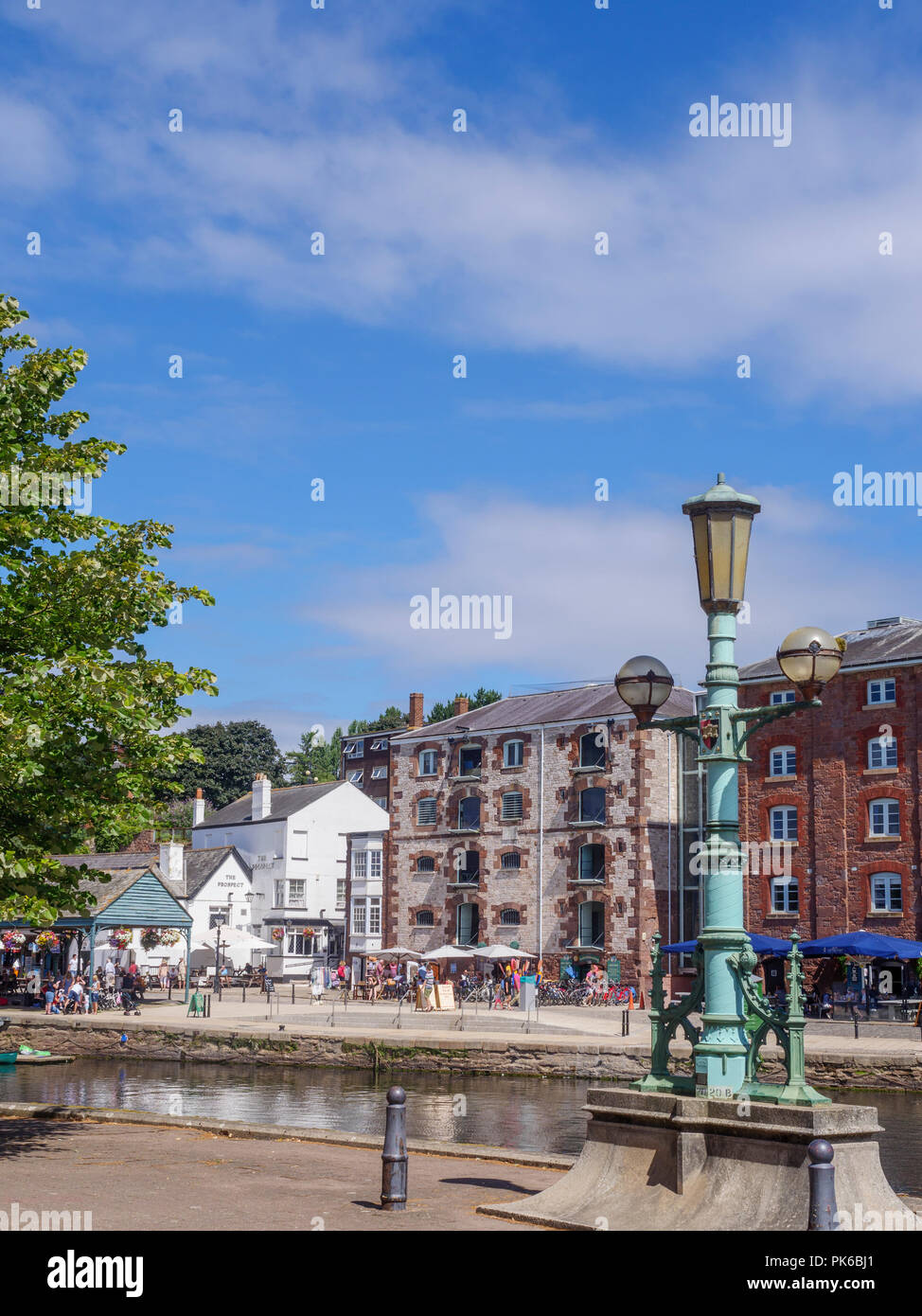 Old bonded warehouses now craft shops River Exe Exeter Quay Exeter Devon England - Stock Image