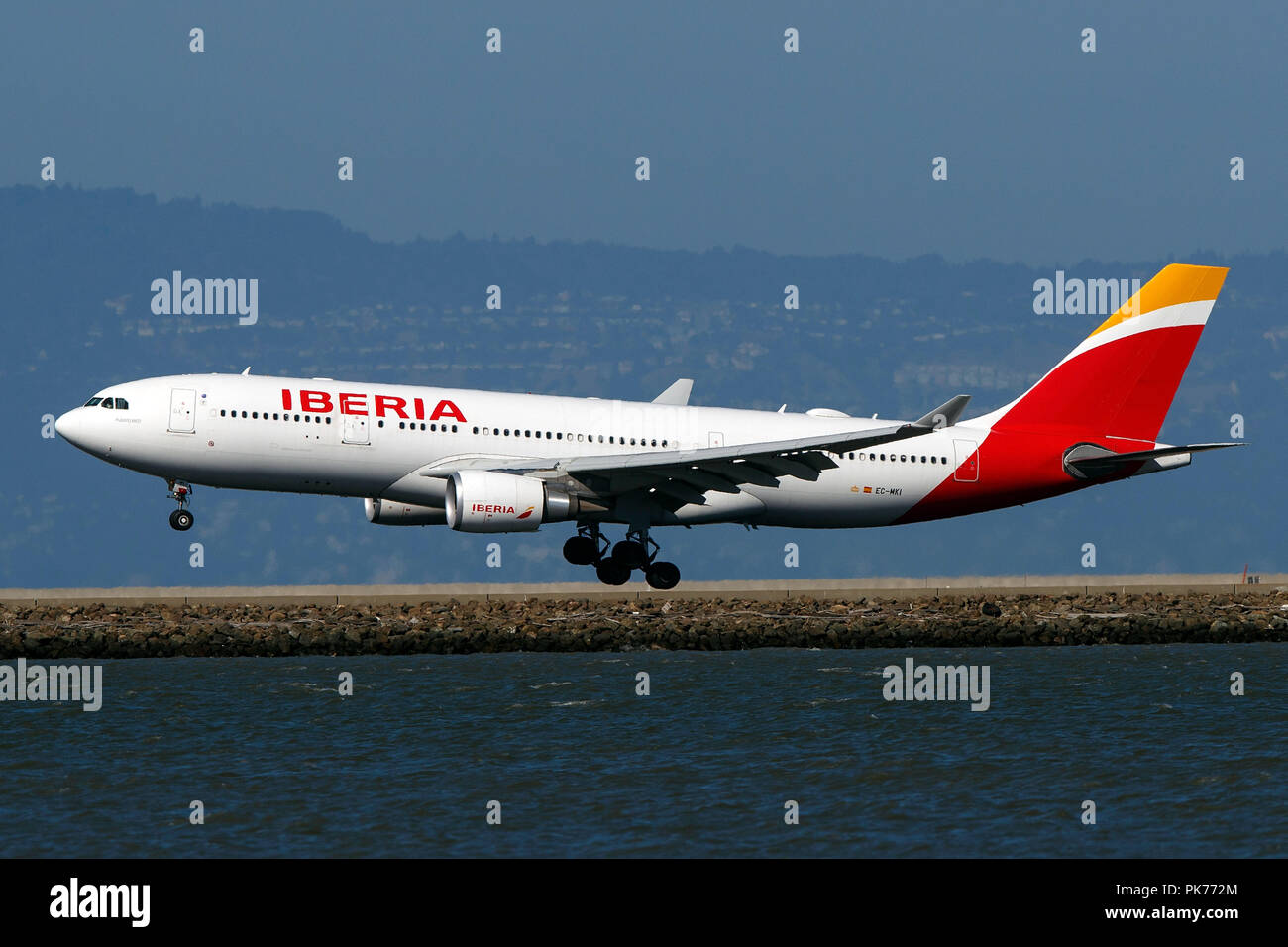 Airbus A330-202 (EC-MKI) operated by Iberia landing at San Francisco International Airport (KSFO), San Francisco, California, United States of America - Stock Image