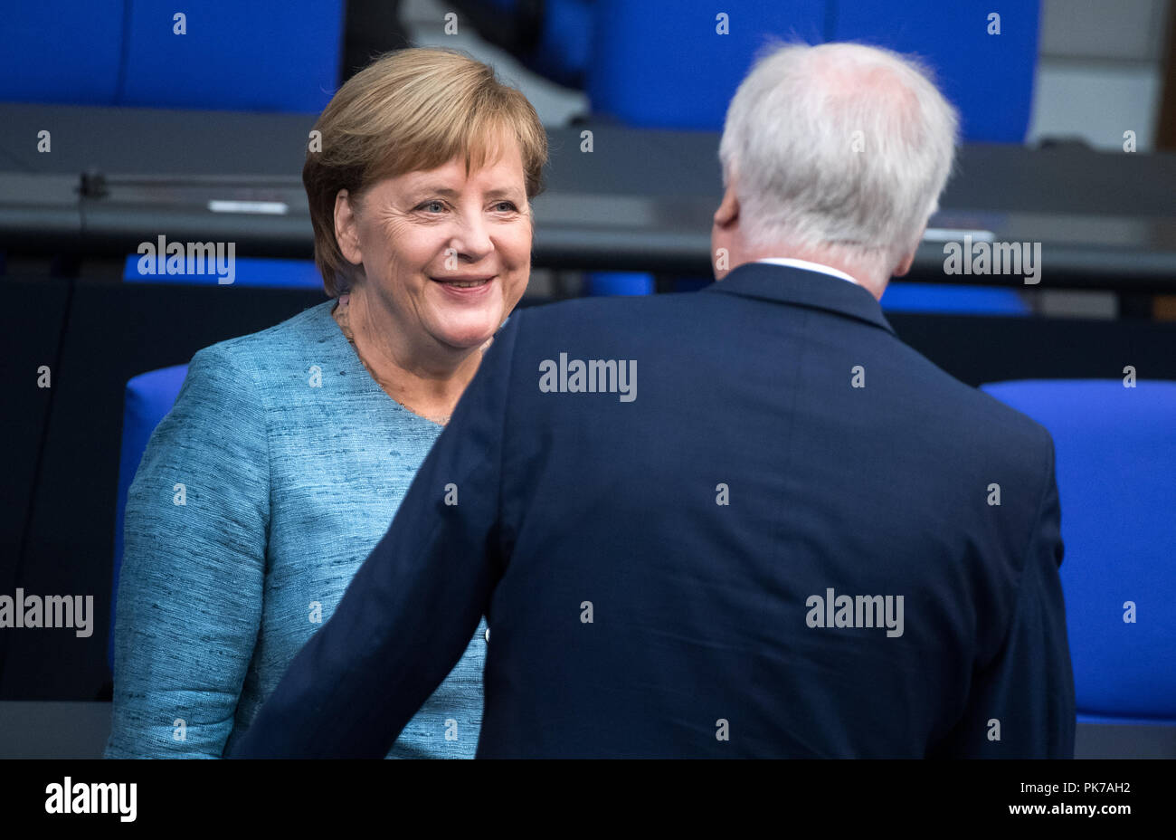 Berlin, Germany. 11th Sept, 2018. German Chancellor Angela Merkel (l, CDU) and Horst Seehofer (CSU), Federal Minister of the Interior, Home and Construction, will discuss the matter at the beginning of the plenary session in the German Bundestag. The main topic of the 47th session of the 19th legislative period is the Federal Government's draft budget 2019 and the federal budget 2018 to 2022. Photo: Kay Nietfeld/dpa Credit: dpa picture alliance/Alamy Live News - Stock Image
