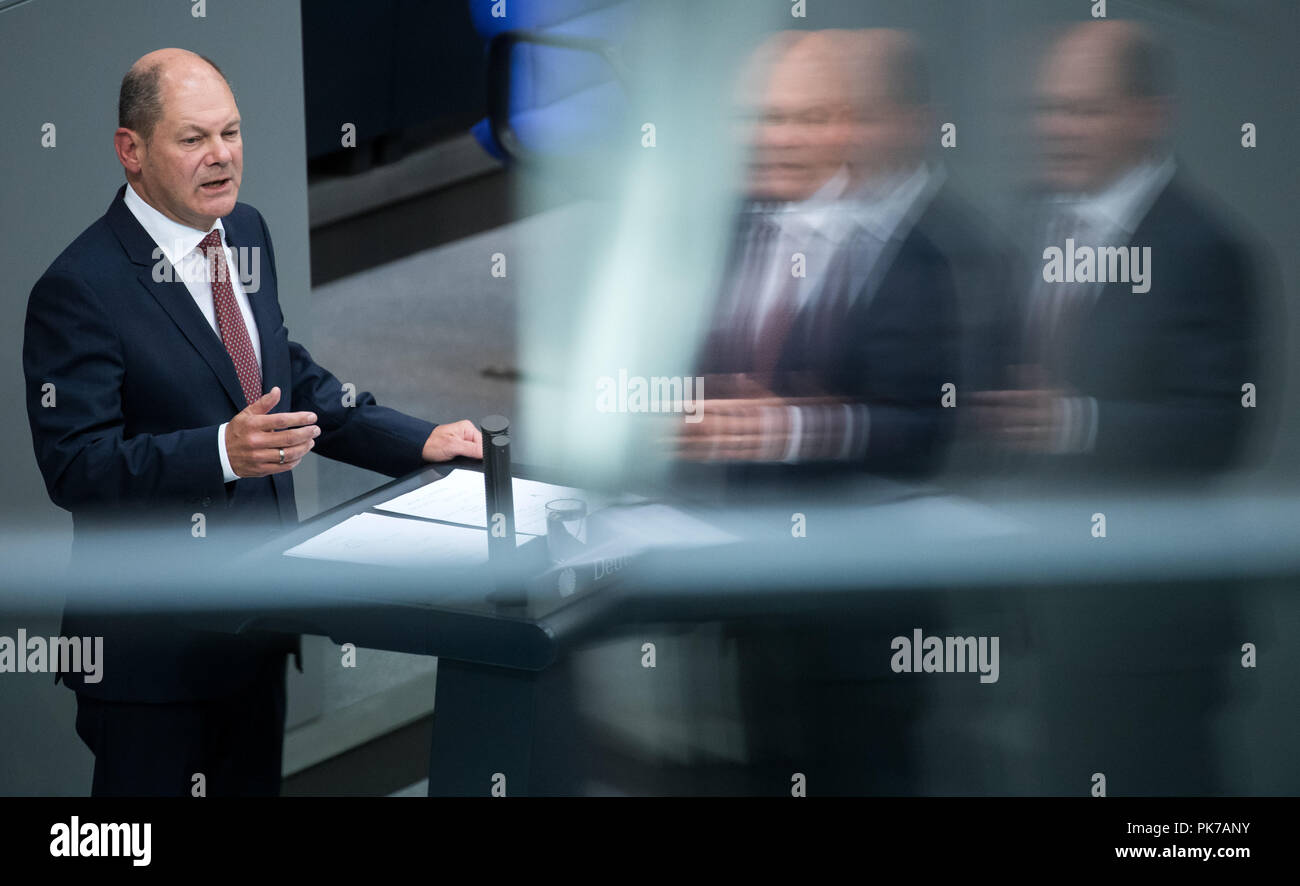Berlin, Germany. 11 September 2018, Berlin: Olaf Scholz (SPD), Federal Minister of Finance, speaks at the plenary session in the German Bundestag. On the right a double reflection of the minister in a glass pane. The main topic of the 47th session of the 19th legislative period is the Federal Government's draft budget 2019 and the federal budget 2018 to 2022. Photo: Bernd von Jutrczenka/dpa Credit: dpa picture alliance/Alamy Live News - Stock Image