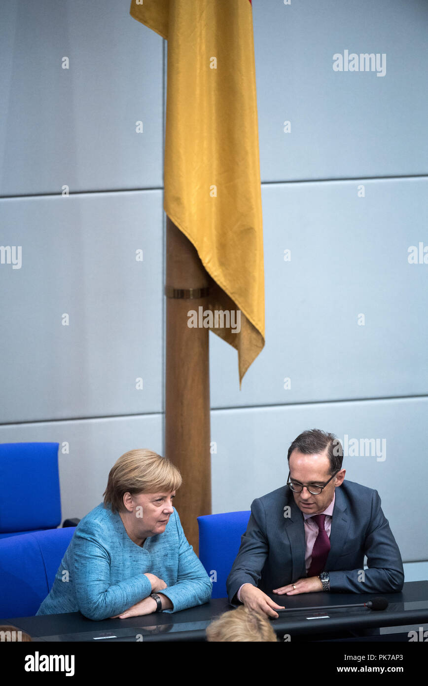 Berlin, Germany. 11 September 2018, Berlin: Chancellor Angela Merkel (l, CDU) and Heiko Maas (SPD), Foreign Minister, are talking during the plenary session in the German Bundestag. The main topic of the 47th session of the 19th legislative period is the Federal Government's draft budget 2019 and the federal budget 2018 to 2022. Photo: Bernd von Jutrczenka/dpa Credit: dpa picture alliance/Alamy Live News - Stock Image