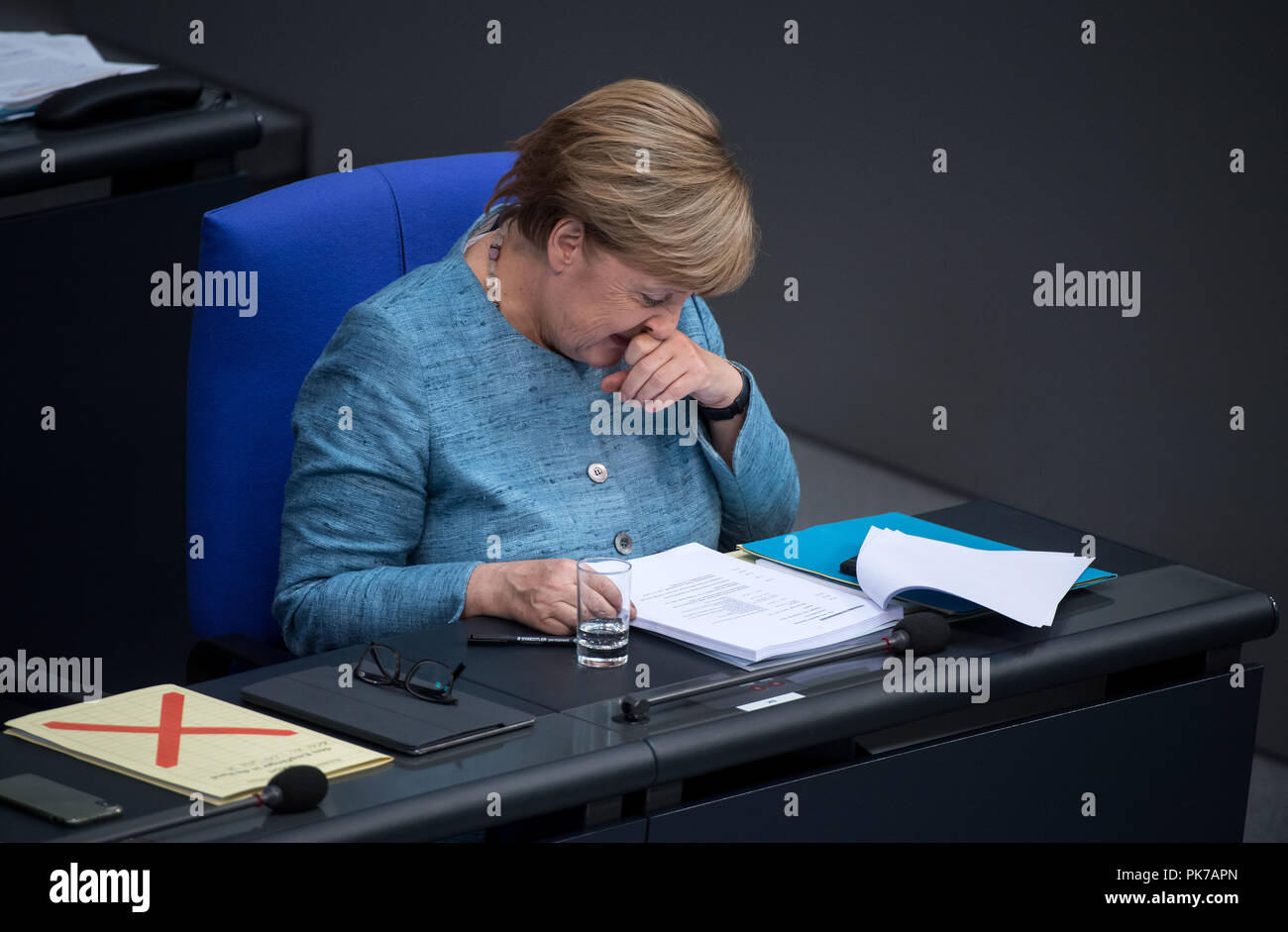 Berlin, Germany. 11 September 2018, Berlin: Chancellor Angela Merkel (CDU) sits in the German Bundestag during the plenary session. The main topic of the 47th session of the 19th legislative period is the Federal Government's draft budget 2019 and the federal budget 2018 to 2022. Photo: Bernd von Jutrczenka/dpa Credit: dpa picture alliance/Alamy Live News - Stock Image
