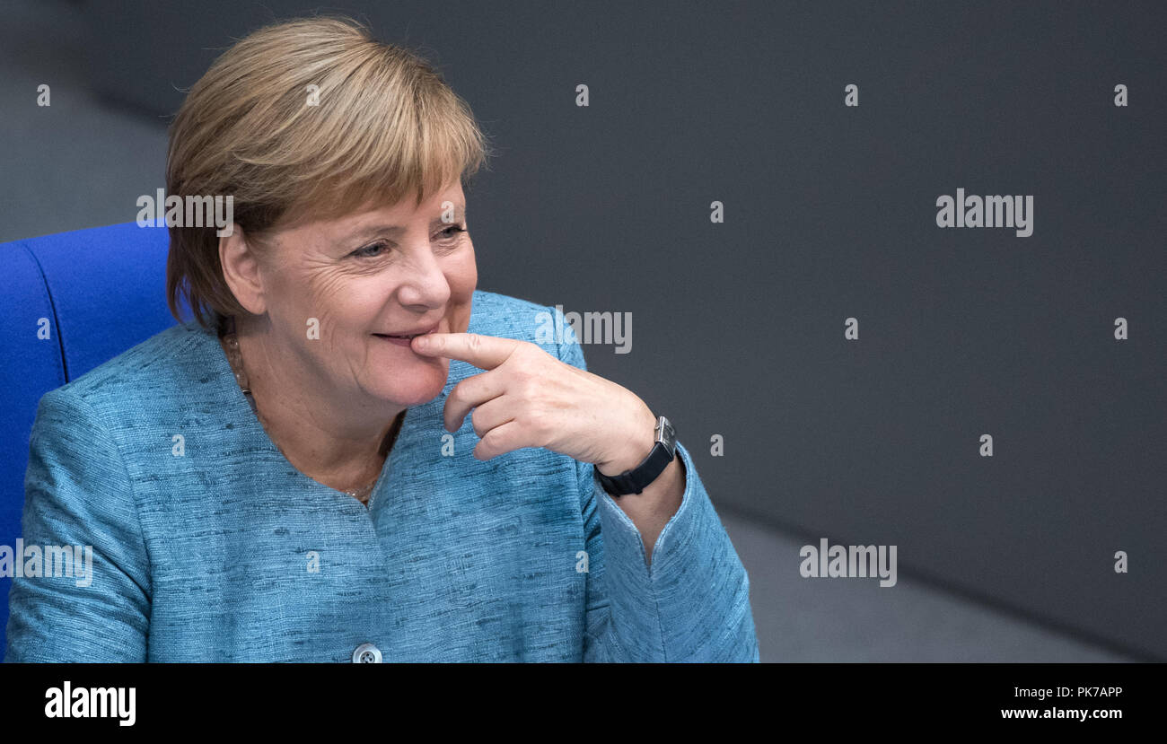 Berlin, Germany. 11 September 2018, Berlin: Chancellor Angela Merkel (CDU) smiles during the plenary session in the German Bundestag. The main topic of the 47th session of the 19th legislative period is the Federal Government's draft budget 2019 and the federal budget 2018 to 2022. Photo: Bernd von Jutrczenka/dpa Credit: dpa picture alliance/Alamy Live News - Stock Image