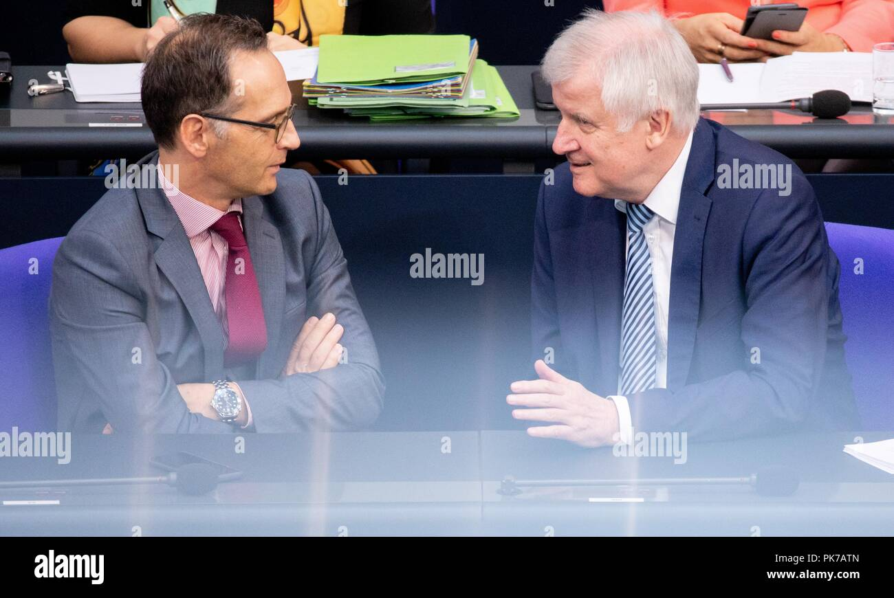 Berlin, Germany. 11 September 2018, Berlin: Horst Seehofer (r, CSU), Federal Minister of the Interior, for Building and Home Affairs, and Heiko Maas (SPD), Foreign Minister, will attend the plenary session in the German Bundestag. The main topic of the 47th session of the 19th legislative period is the Federal Government's draft budget 2019 and the federal budget 2018 to 2022. Photo: Bernd von Jutrczenka/dpa Credit: dpa picture alliance/Alamy Live News - Stock Image