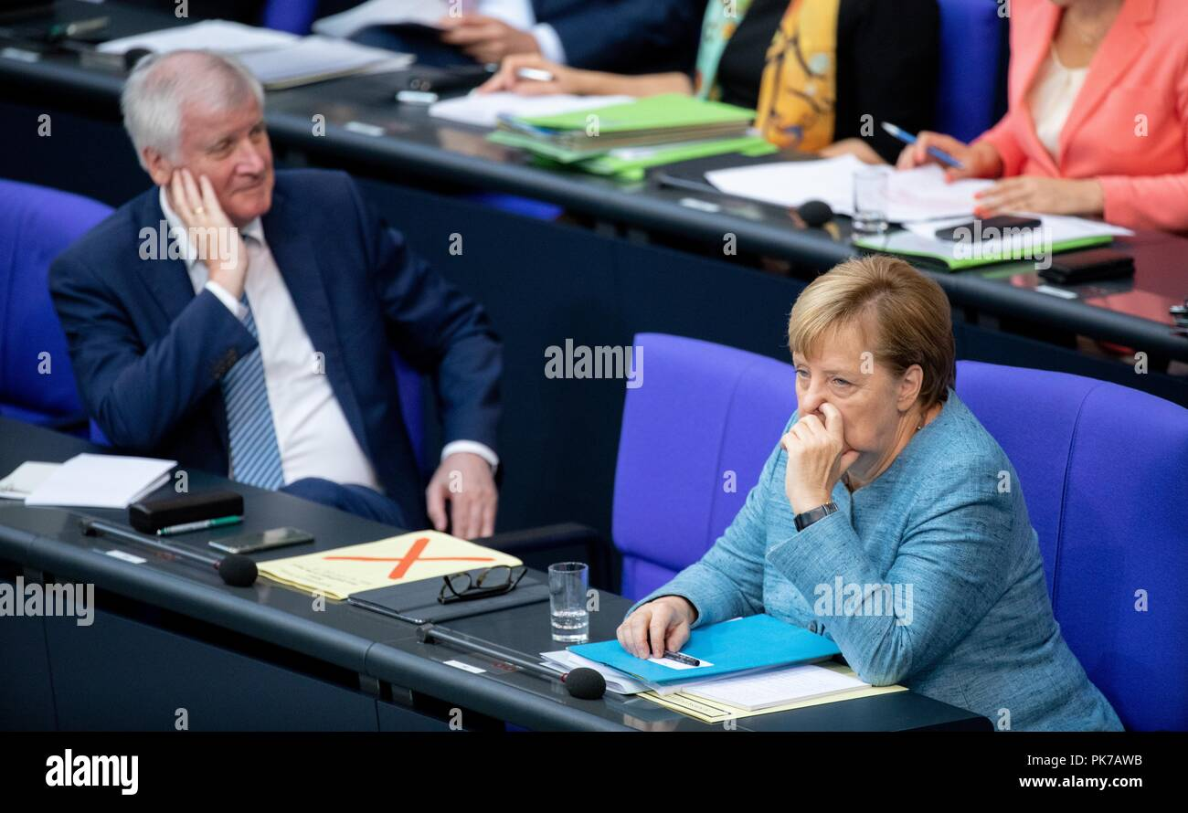 Berlin, Germany. 11 September 2018, Berlin: Horst Seehofer (CSU), Federal Minister of the Interior, for Building and Home Affairs, and Chancellor Angela Merkel (CDU) will participate in the plenary session in the German Bundestag. The main topic of the 47th session of the 19th legislative period is the Federal Government's draft budget 2019 and the federal budget 2018 to 2022. Photo: Bernd von Jutrczenka/dpa Credit: dpa picture alliance/Alamy Live News - Stock Image