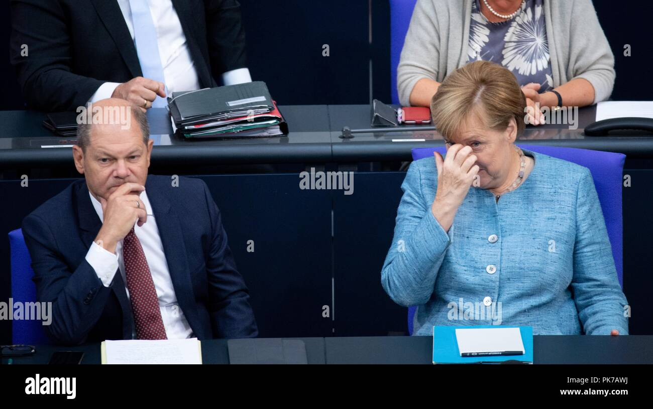 Berlin, Germany. 11 September 2018, Berlin: Olaf Scholz (SPD), Federal Minister of Finance, and Chancellor Angela Merkel (CDU) will attend the plenary session in the German Bundestag. The main topic of the 47th session of the 19th legislative period is the Federal Government's draft budget 2019 and the federal budget 2018 to 2022. Photo: Bernd von Jutrczenka/dpa Credit: dpa picture alliance/Alamy Live News - Stock Image