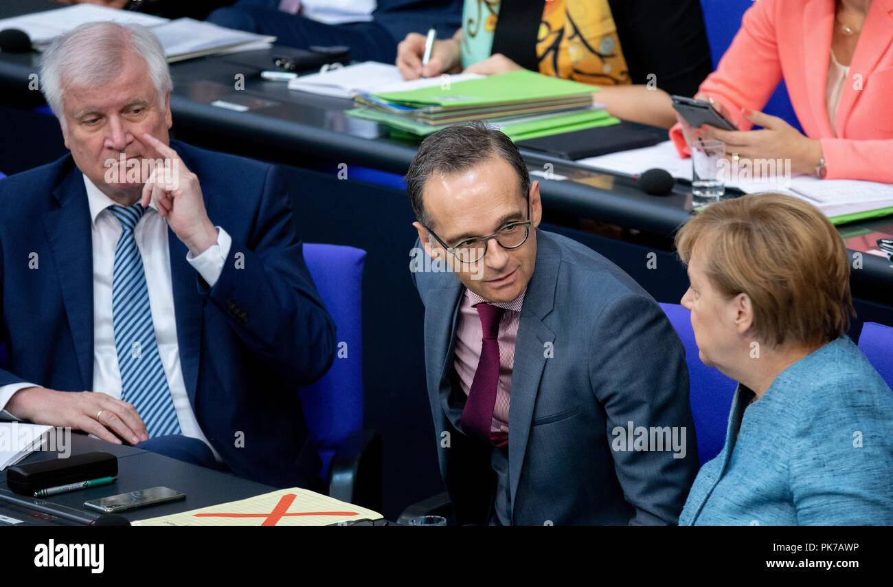 Berlin, Germany. 11 September 2018, Berlin: Horst Seehofer, Federal Minister of the Interior, for Building and Home Affairs (l-r,CSU), Heiko Maas (SPD), Foreign Minister and Chancellor Angela Merkel (CDU) will attend the plenary session in the German Bundestag. The main topic of the 47th session of the 19th legislative period is the Federal Government's draft budget 2019 and the federal budget 2018 to 2022. Photo: Bernd von Jutrczenka/dpa Credit: dpa picture alliance/Alamy Live News - Stock Image