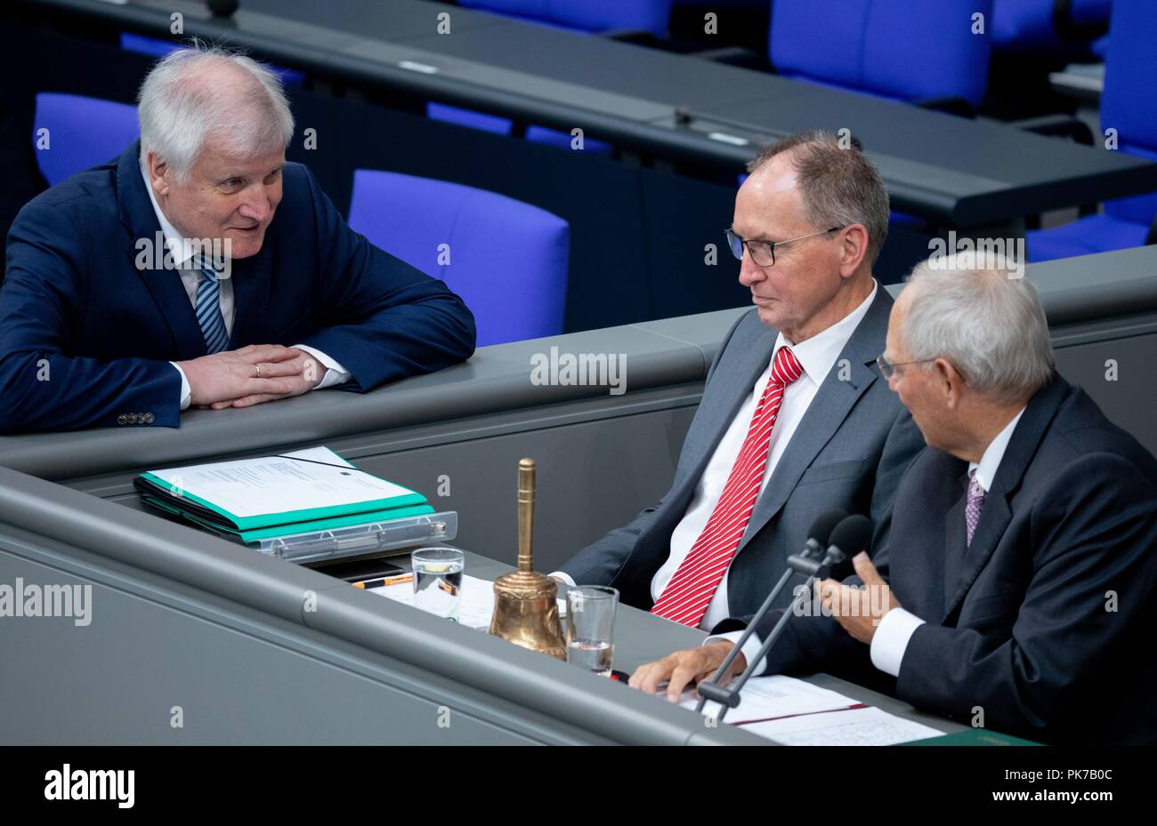 Berlin, Germany. 11 September 2018, Berlin: Horst Seehofer (CSU, l), Federal Minister of the Interior, for Building and Home, speaks to Wolfgang Schäuble (CDU, r), President of the Bundestag, at the plenary session in the German Bundestag. The main topic of the 47th session of the 19th legislative period is the Federal Government's draft budget 2019 and the federal budget 2018 to 2022. Photo: Bernd von Jutrczenka/dpa Credit: dpa picture alliance/Alamy Live News - Stock Image