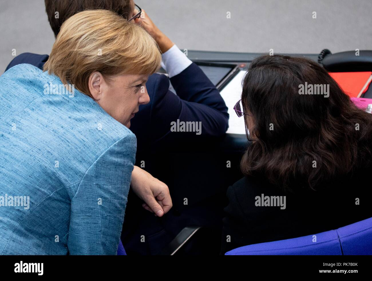 Berlin, Germany. 11 September 2018, Berlin: Chancellor Angela Merkel (CDU) will speak to Andrea Nahles (r), SPD faction leader and SPD party leader, at the plenary session in the German Bundestag. The main topic of the 47th session of the 19th legislative period is the Federal Government's draft budget 2019 and the federal budget 2018 to 2022. Photo: Bernd von Jutrczenka/dpa Credit: dpa picture alliance/Alamy Live News - Stock Image