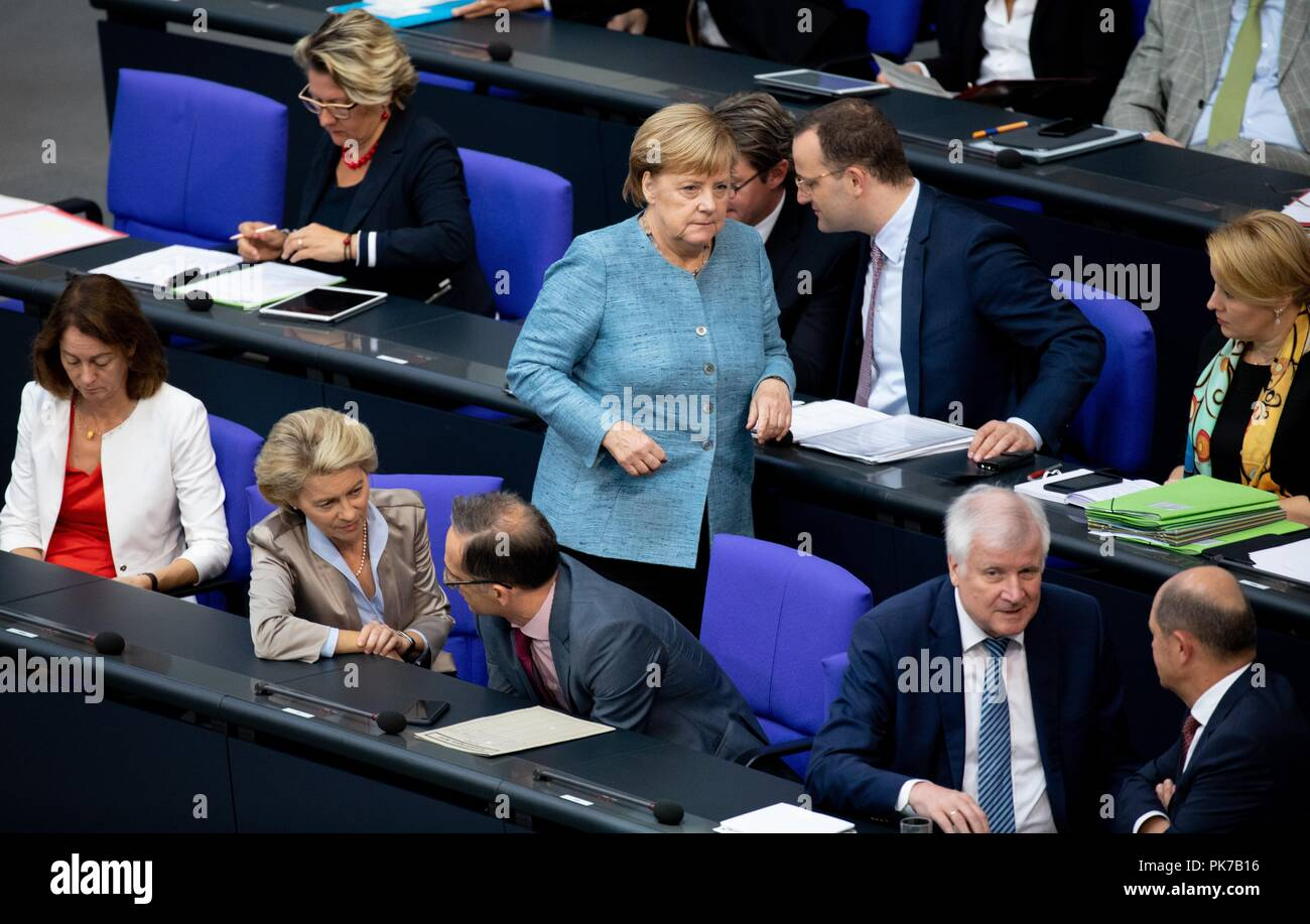 Berlin, Germany. 11 September 2018, Berlin: Chancellor Angela Merkel (CDU) will pass through the government bank at the plenary session in the German Bundestag. The main topic of the 47th session of the 19th legislative period is the Federal Government's draft budget 2019 and the federal budget 2018 to 2022. Photo: Bernd von Jutrczenka/dpa Credit: dpa picture alliance/Alamy Live News - Stock Image