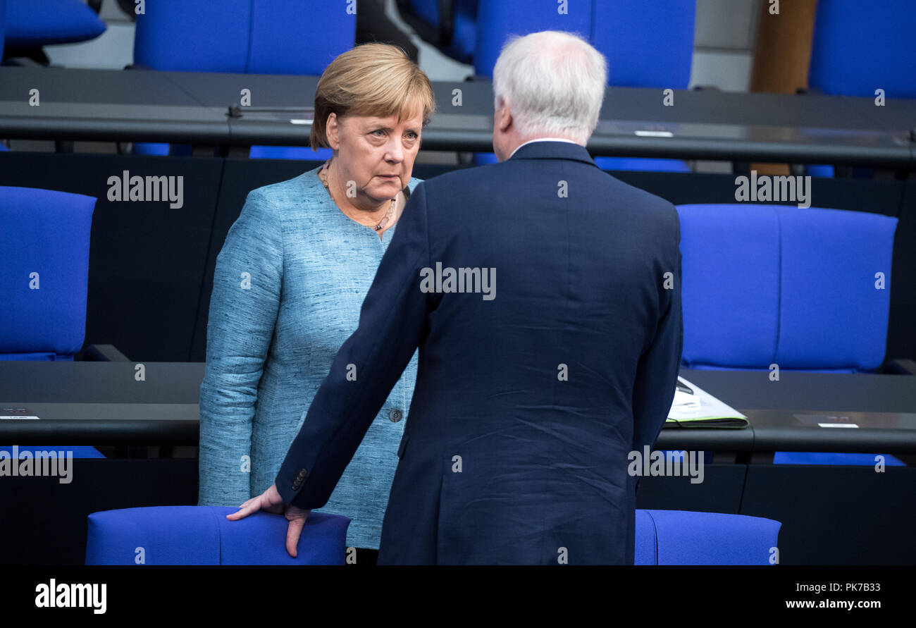 Berlin, Germany. 11 September 2018, Berlin: German Chancellor Angela Merkel (CDU) will hear Horst Seehofer (CSU), Federal Minister of the Interior, Home and Building, at the beginning of the plenary session in the German Bundestag. The main topic of the 47th session of the 19th legislative period is the Federal Government's draft budget 2019 and the federal budget 2018 to 2022. Photo: Bernd von Jutrczenka/dpa Credit: dpa picture alliance/Alamy Live News - Stock Image