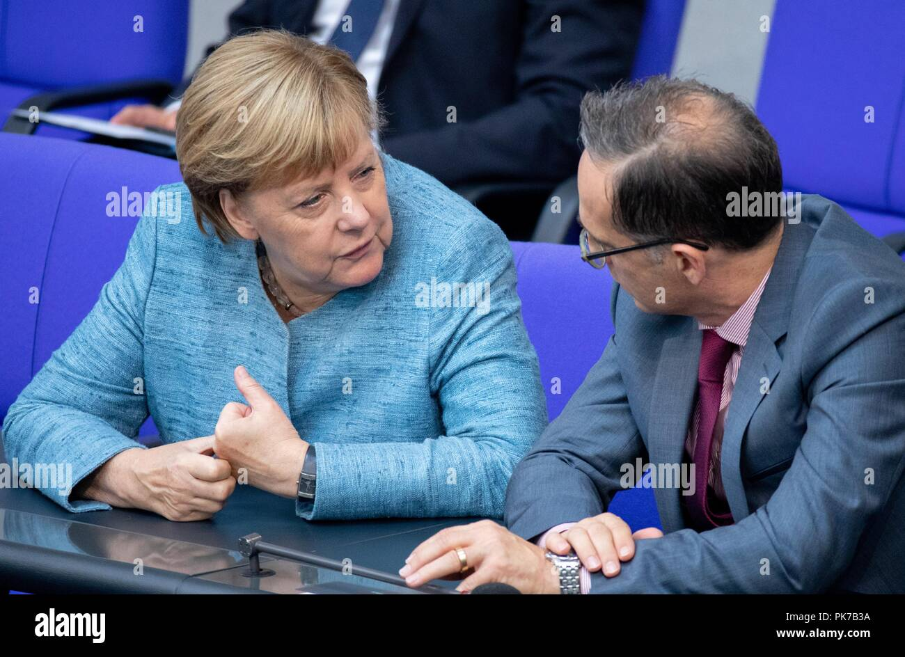 Berlin, Germany. 11 September 2018, Berlin: Chancellor Angela Merkel (CDU) and Heiko Maas (SPD), Foreign Minister, are talking at the plenary session in the German Bundestag. The main topic of the 47th session of the 19th legislative period is the Federal Government's draft budget 2019 and the federal budget 2018 to 2022. Photo: Bernd von Jutrczenka/dpa Credit: dpa picture alliance/Alamy Live News - Stock Image