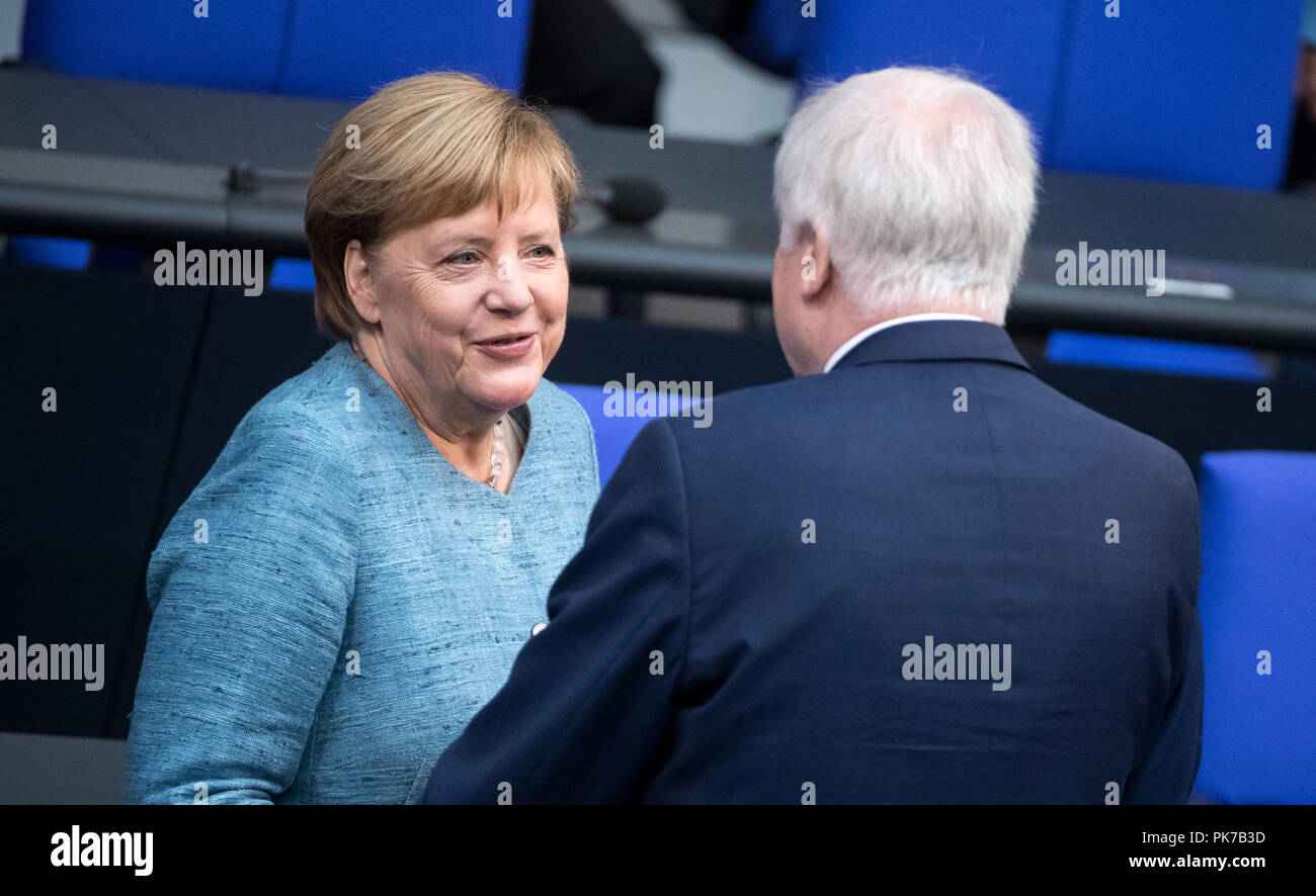 Berlin, Germany. 11 September 2018, Berlin: German Chancellor Angela Merkel (CDU) and Horst Seehofer (CSU), Federal Minister of the Interior, Home and Building, will discuss the matter at the beginning of the plenary session in the German Bundestag. The main topic of the 47th session of the 19th legislative period is the Federal Government's draft budget 2019 and the federal budget 2018 to 2022. Photo: Bernd von Jutrczenka/dpa Credit: dpa picture alliance/Alamy Live News - Stock Image