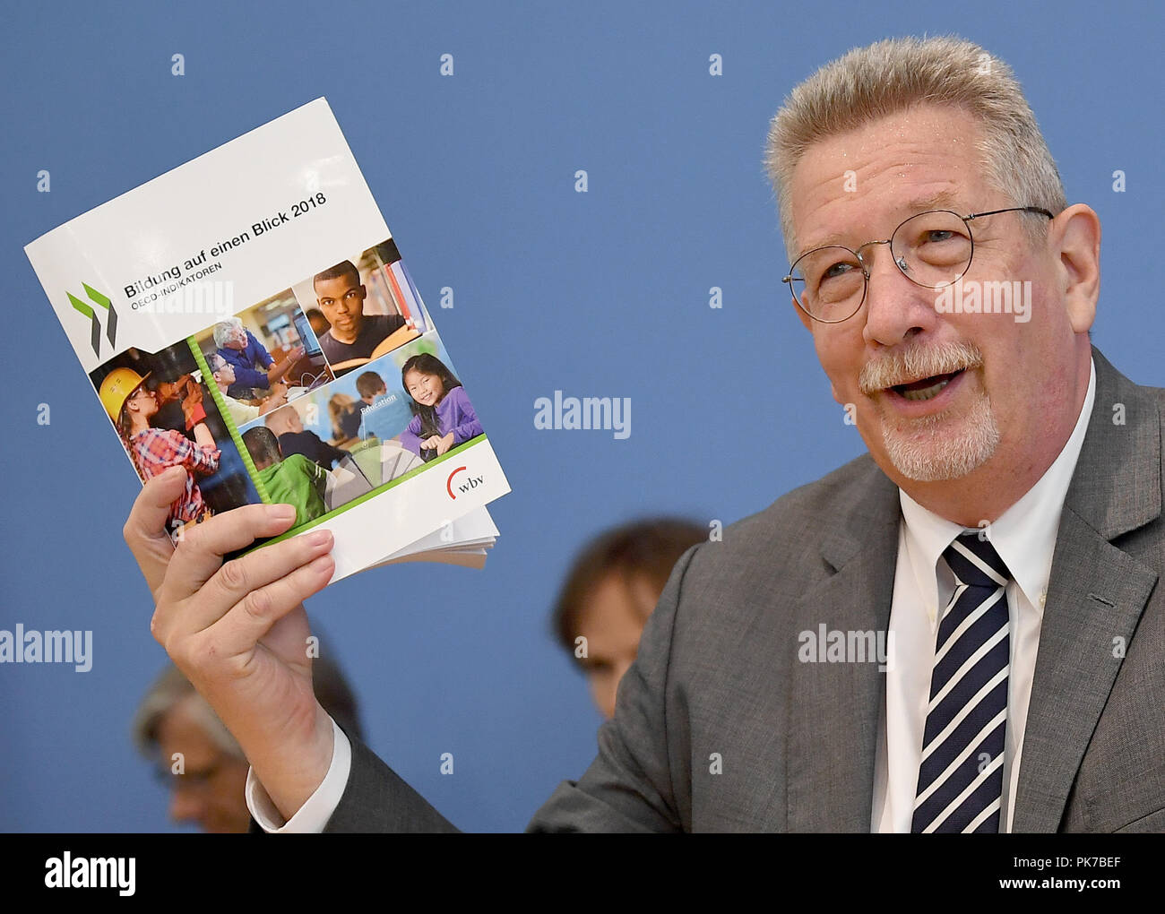 11 September 2018, Berlin: Heino von Meyer, Head of the OECD Berlin Centre speaks at the presentation of the OECD report 'Education at a Glance 2018'. OECD is the abbreviation for the Organisation for Economic Cooperation and Development. Photo: Britta Pedersen/dpa-Zentralbild/dpa - Stock Image