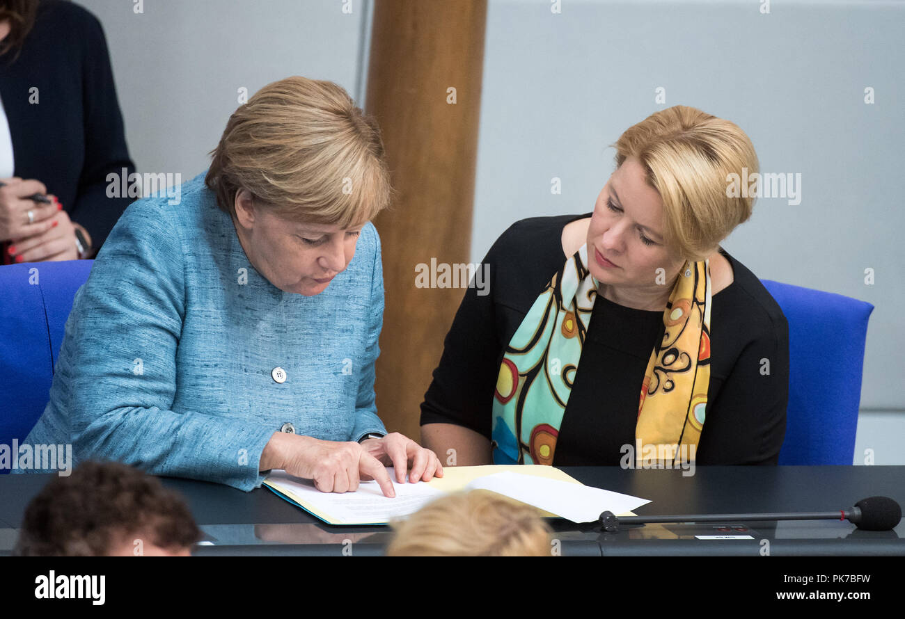 Berlin, Germany. 11 September 2018, Berlin: Chancellor Angela Merkel (l, CDU) and Franziska Giffey (SPD), Federal Minister for Family Affairs, are talking during the plenary session in the German Bundestag. The main topic of the 47th session of the 19th legislative period is the Federal Government's draft budget 2019 and the federal budget 2018 to 2022. Photo: Bernd von Jutrczenka/dpa Credit: dpa picture alliance/Alamy Live News - Stock Image