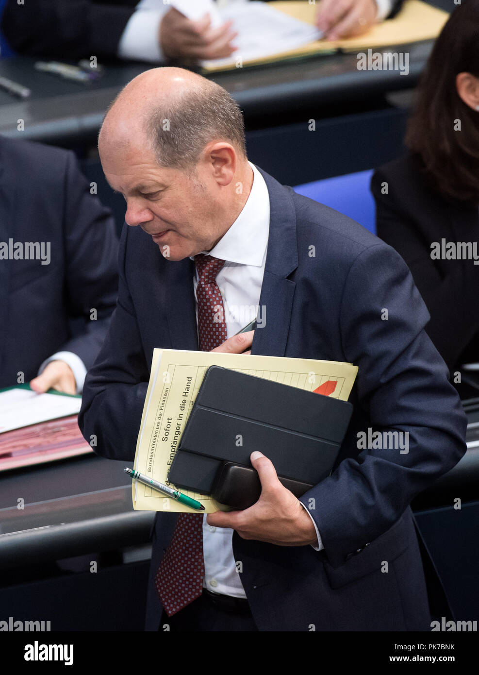 Berlin, Germany. 11 September 2018, Berlin: Olaf Scholz (SPD), Federal Minister of Finance, leaves the plenary session in the German Bundestag. The main topic of the 47th session of the 19th legislative period is the Federal Government's draft budget 2019 and the federal budget 2018 to 2022. Photo: Bernd von Jutrczenka/dpa Credit: dpa picture alliance/Alamy Live News - Stock Image