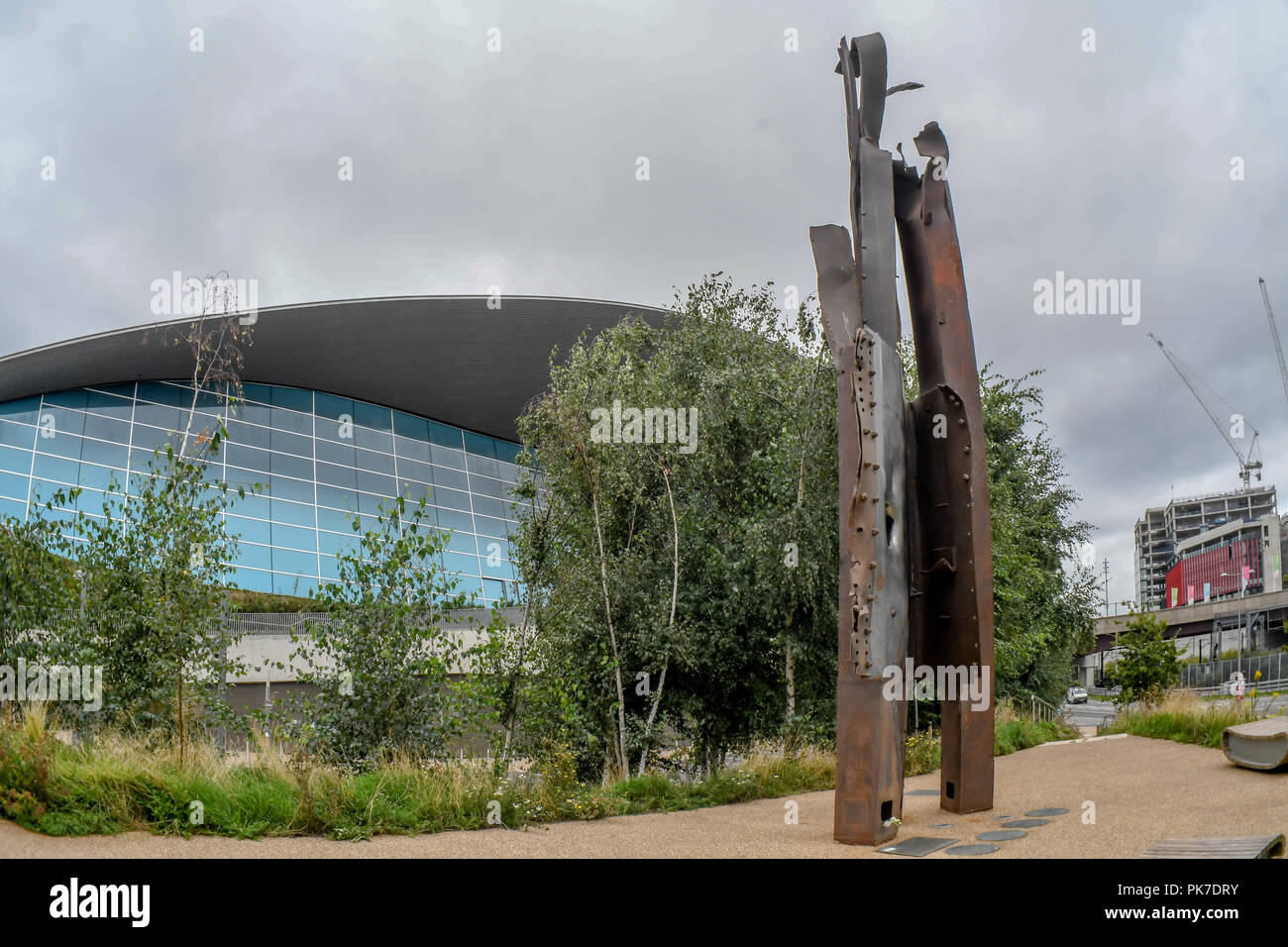 911 steel beam structure In The Olympic Park, London, UK. 11th September 2018. The 911 steel beam structure a Memorial In The Olympic Park. A memories of September 11, 2001 attack of 3,000 death. The world never is the same again 17 years later from Al Qaeda 's to Taliban, IS, Daesh to ISIS? or regimes change? logic seven largely Muslim countries (Afghanistan, Iraq, Libya, Pakistan, Somalia, Syria, and Yemen) none of them has any link to the 9/11 attacks? and destroyed 20 million Arabs/Muslim killed and over 65 millions refugees?. Who is our real enemy of mankind, an enemy of humanity? shouldn - Stock Image