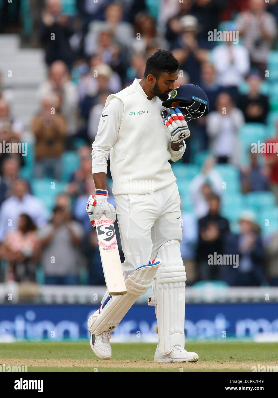 Kia Oval, London, UK. 11th Sep, 2018. Specsavers International Test Match Cricket, 5th test, day 5; KL Rahul of India kisses the badge on his helmet as he reaches his century Credit: Action Plus Sports/Alamy Live News - Stock Image