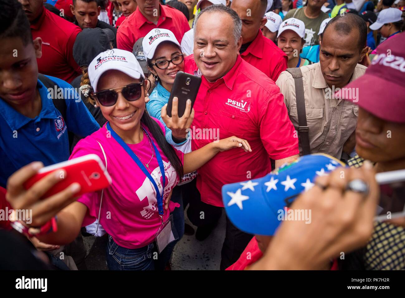 Caracas, Venezuela. 11th Sep, 2018. President of the National Constituent Assembly (ANC) Diosdado Cabello and supporters of Nicolas Maduro's Government demonstrate against the US 'imperialism' in Caracas, Venezuela, 11 September 2018. Thousands of sympathizers marched in support of the Venezuelan President, who advances an economic package rejected by experts and the opposition, as well as 'against US imperialism', which they accused of threatening the stability of the oil country. Credit: Miguel Gutierrez/EFE/Alamy Live News - Stock Image