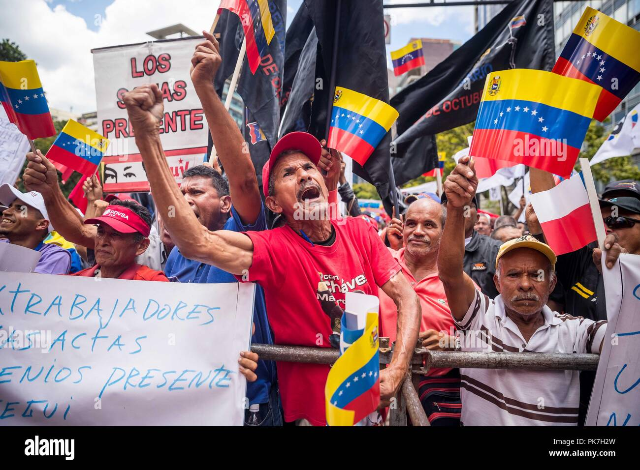 Caracas, Venezuela. 11th Sep, 2018. Supporters of Nicolas Maduro's Government demonstrate against the US 'imperialism' in Caracas, Venezuela, 11 September 2018. Thousands of sympathizers marched in support of the Venezuelan President, who advances an economic package rejected by experts and the opposition, as well as 'against US imperialism', which they accused of threatening the stability of the oil country. Credit: Miguel Gutierrez/EFE/Alamy Live News - Stock Image