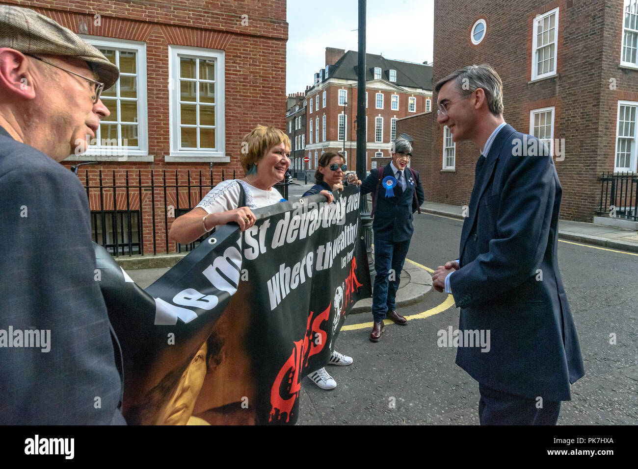 London, UK. 11th Sept 2018. Class War at the £5.6m Westminster town house of Jacob Rees-Mogg with street theatre calling for the release of Veronica Cook, his nanny who now looks after him and his six children. They say she ceased to exist as an independent human 50 years ago and has been subsumed into the Mogg family as if she was being confined in the tower of a gothic mansion. The protest starred former Class War Westminster candidate Adam Clifford as Jacob Rees-Mogg and Jane Nicholl as Nanny Crook, as well as a giant penis and offered escape to Veronica Cook, saying she is paid at below th Stock Photo