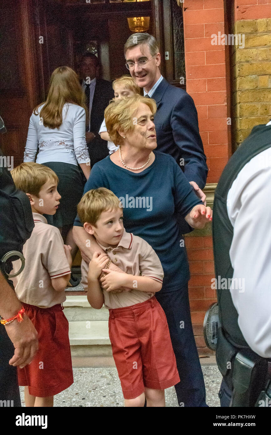 London, UK. 11th Sept 2018. The Rees-Moggs and Nanny Cook start to go back inside as Class War at the £5.6m Westminster town house calling for the release of Veronica Cook, his nanny who now looks after him and his six children. They say she ceased to exist as an independent human 50 years ago and has been subsumed into the Mogg family as if she was being confined in the tower of a gothic mansion. The protest starred former Class War Westminster candidate Adam Clifford as Jacob Rees-Mogg and Jane Nicholl as Nanny Crook, as well as a giant penis and offered escape to Veronica Cook, saying she i Stock Photo