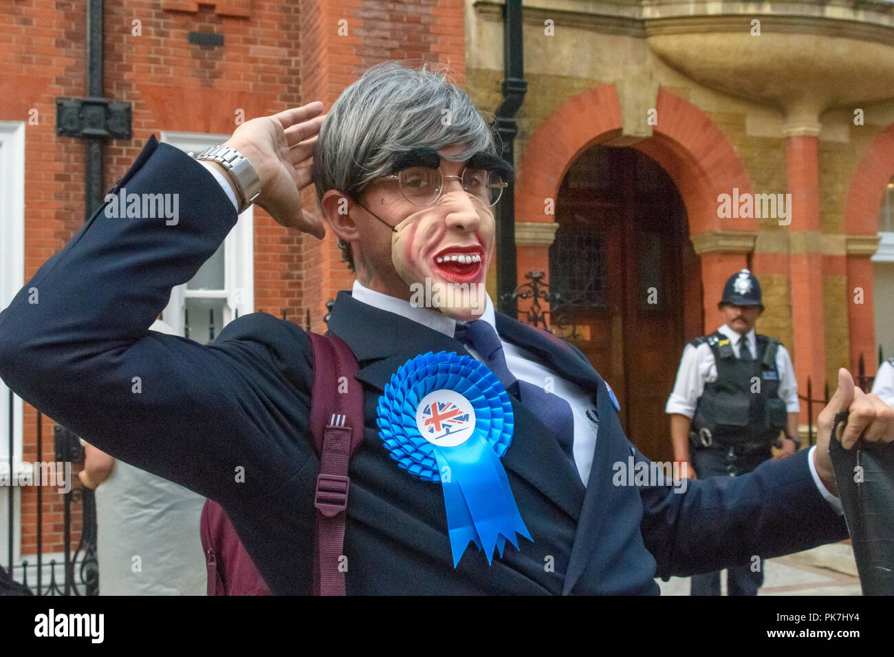 London, UK. 11th Sept 2018. Adam Clifford in costume as Jacob Rees-Mogg at the Class War protest outside the £5.6m  Westminster town house of Jacob Rees-Mogg calling for the release of Veronica Cook, his nanny who now looks after him and his six children. They say she ceased to exist as an independent human 50 years ago and has been subsumed into the Mogg family as if she was being confined in the tower of a gothic mansion. d offered escape to Credit: Peter Marshall/Alamy Live News Stock Photo