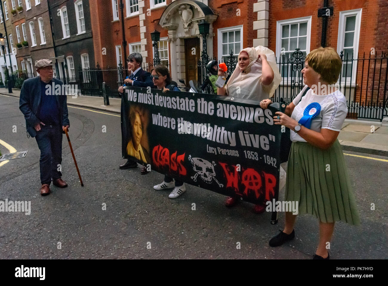 London, UK. 11th Sept 2018. Class War protesters including a woman dressed as a giant penis at the Class War protest outside the £5.6m  Westminster town house of Jacob Rees-Mogg calling for the release of Veronica Cook, his nanny who now looks after him and his six children. They say she ceased to exist as an independent human 50 years ago and has been subsumed into the Mogg family as if she was being confined in the tower of a gothic mansion. Credit: Peter Marshall/Alamy Live News Stock Photo