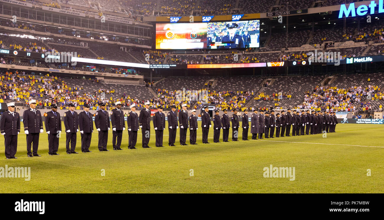 East Rutherford, NJ - September 11, 2018: NYPD officers and FDNY members attend friendly match against Colombia at MetLife Stadium Credit: lev radin/Alamy Live News - Stock Image