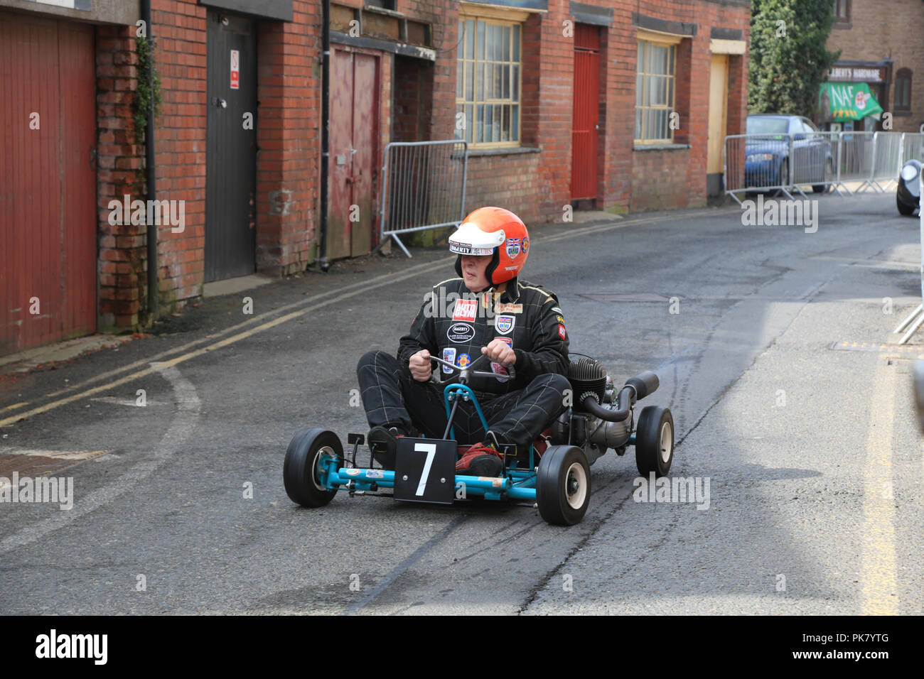 "Barrie ""Whizzo"" Williams driving a cart through the streets of Bromyard during the Bromyard speed festival in 2016. Stock Photo"