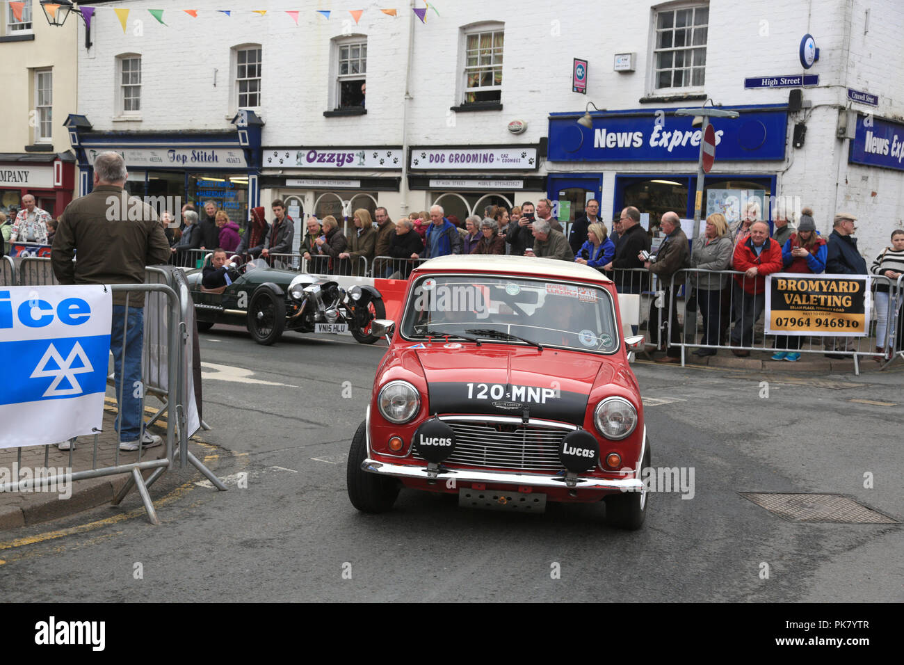 """Barrie """"Whizzo"""" Williams driving his Welsh rally winning Mini Cooper S through the streets of Bromyard in 2016. Stock Photo"""