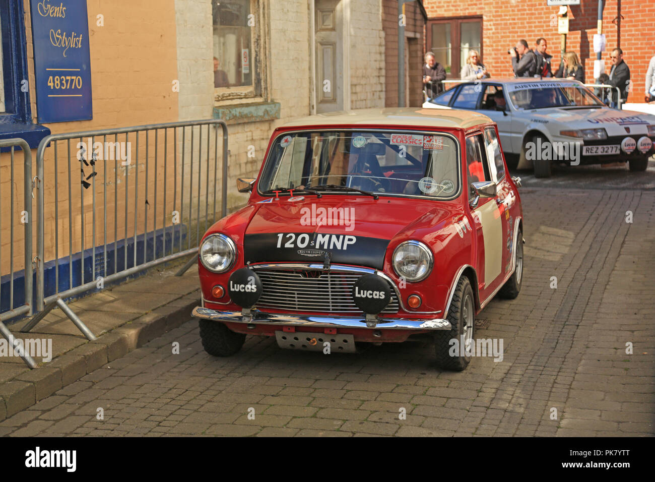 """Barrie """"Whizzo"""" Williams driving his Welsh rally winning Mini Cooper S through the streets of Bromyard in 2017. Stock Photo"""