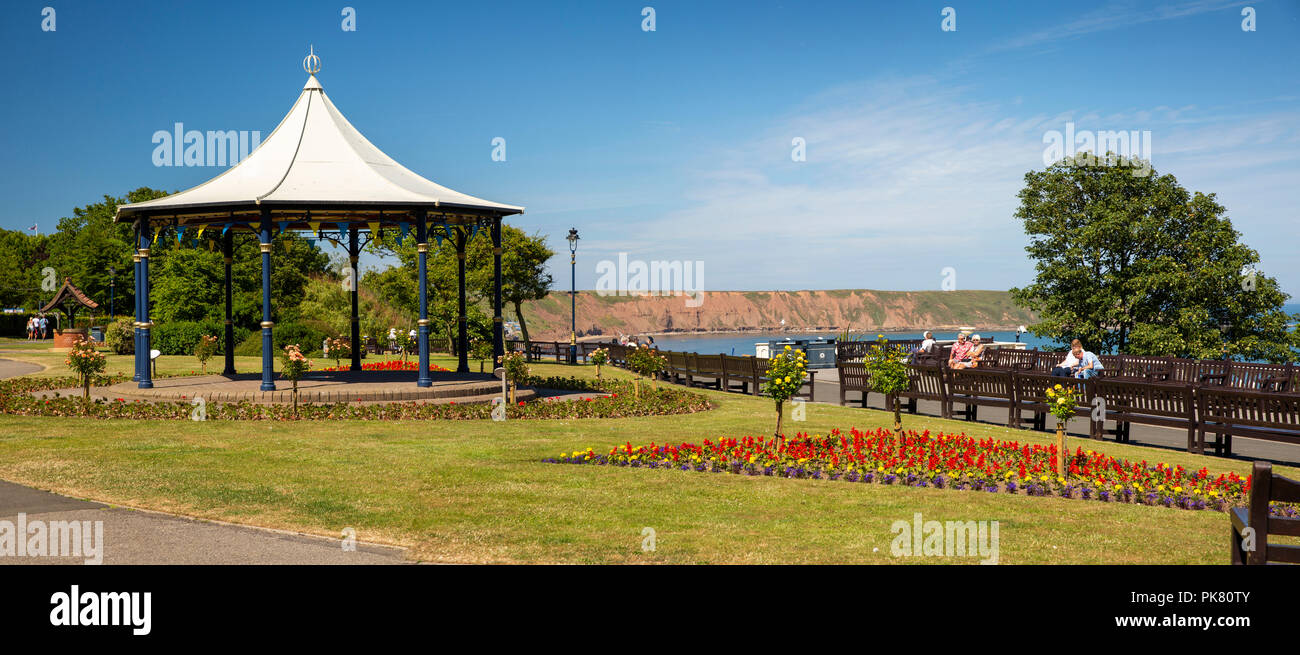UK, England, Yorkshire, Filey, Crescent Garden, bandstand and floral planting, panoramic - Stock Image