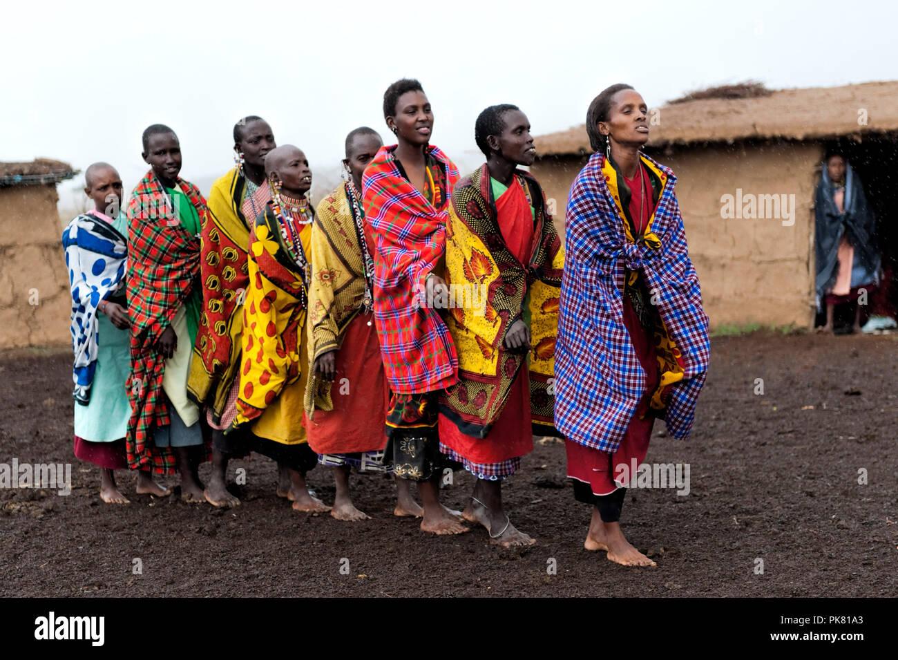 Group of Masai Ladies wearing traditional clothing  preparing to do a local dance Masai Mara Kenya East Africa - Stock Image