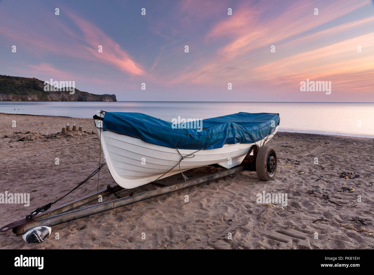 Dawn breaking over Sandsend beach near Whitby on the North Yorkshire coast, England. Stock Photo