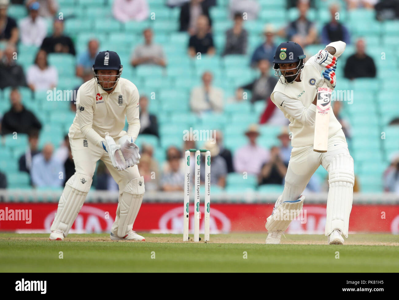 India's KL Rahul (right) hits out for a boundary during the test match at The Kia Oval, London. - Stock Image