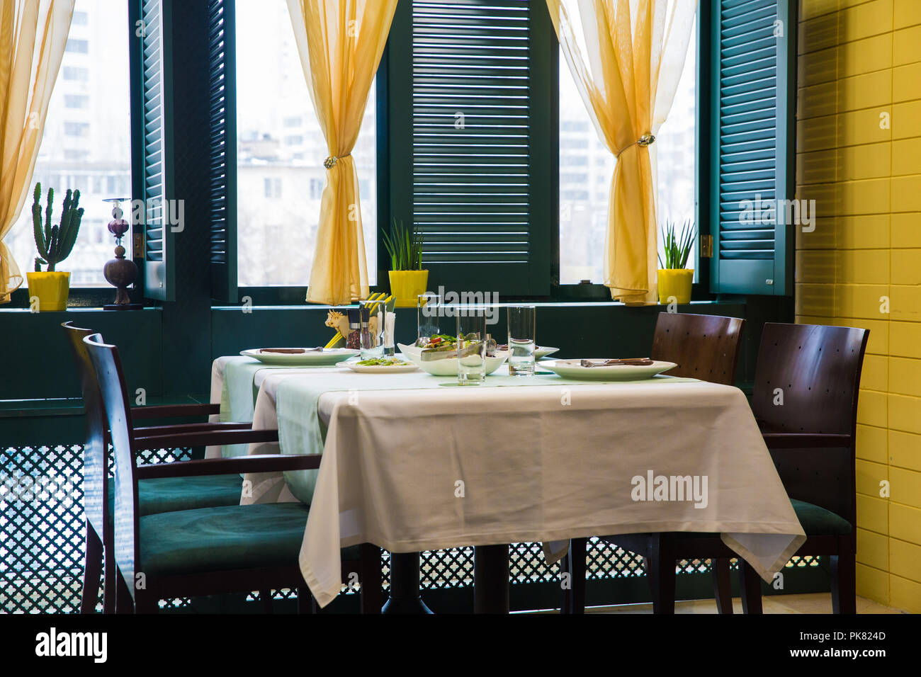 Cafe Table Setting Yellow And Green Color Table By The Window Wooden Window Blinds Stock Photo Alamy
